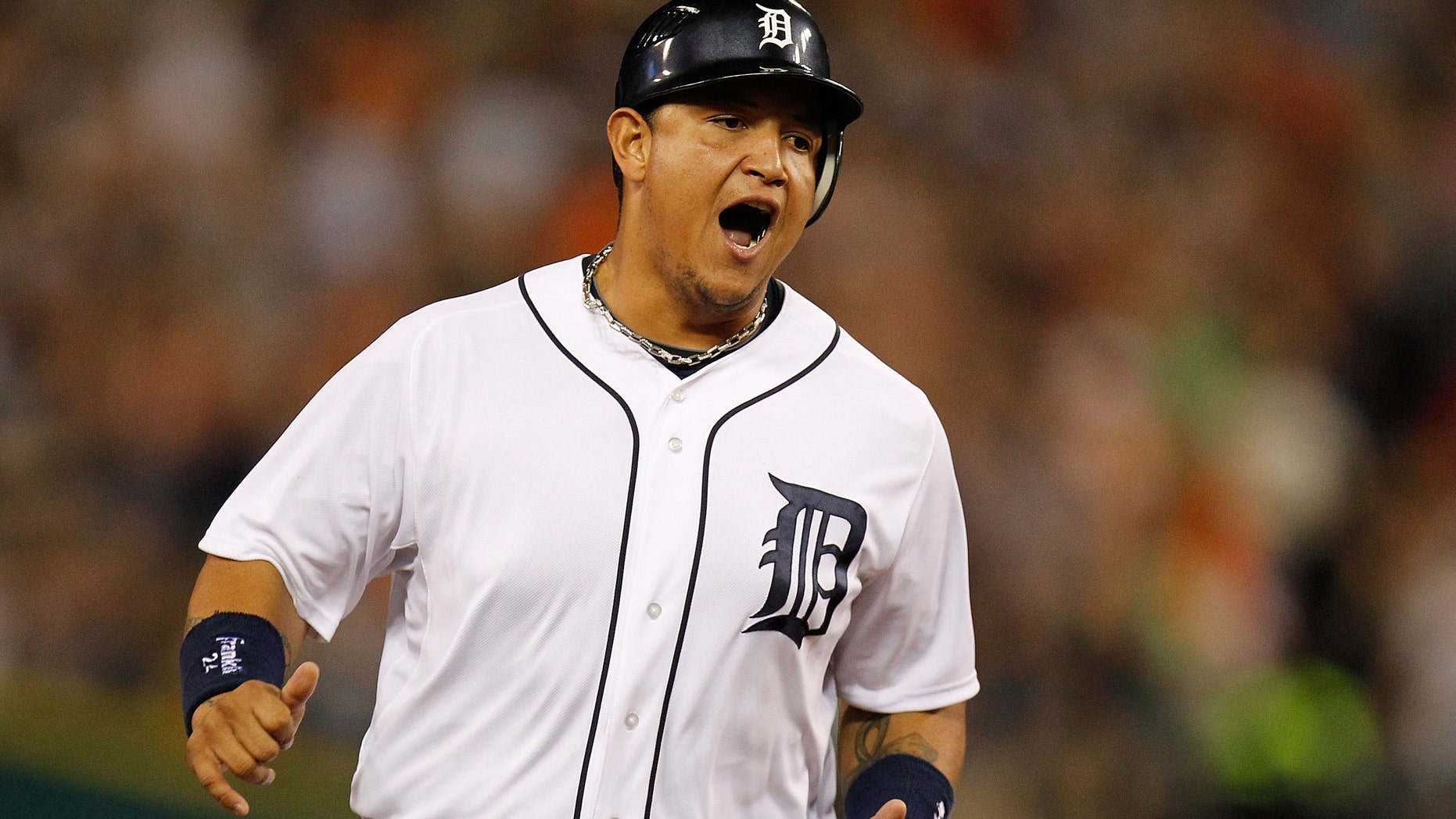DETROIT, MI - SEPTEMBER 02: Miguel Cabrera #24 of the Detroit Tigers reacts to a sixth inning home run by Delmon Young #21 while playing the Chicago White Sox at Comerica Park on September 2, 2012 in Detroit, Michigan.  (Photo by Gregory Shamus/Getty Images)
