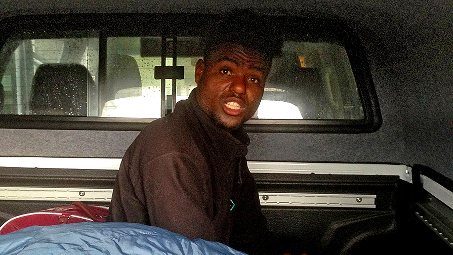 Paul Edmunds from Caersws, Wales opened his car boot after arriving home from a recent trip to France with friends, to find this migrant hiding inside. It's believed that the refugee snuck into the vehicle when they made a pitstop in Calais, France.