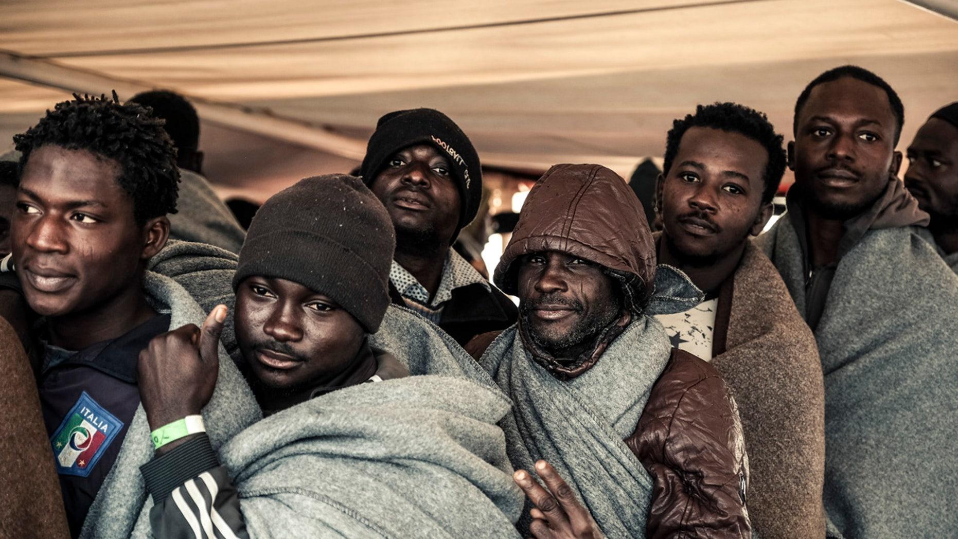Migrants arrive at the Trapani harbor in Italy in November 2017.