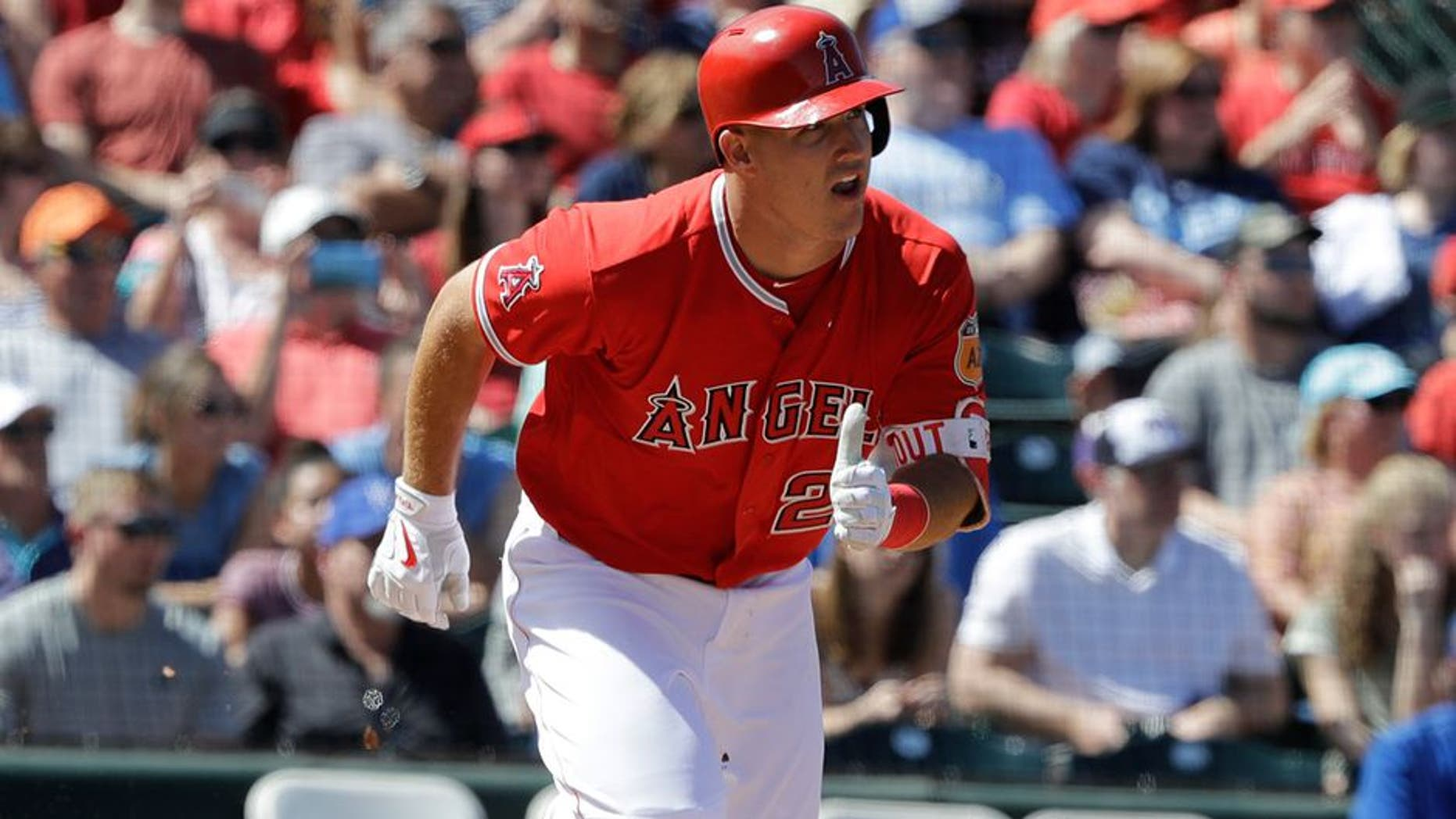 Los Angeles Angels' Mike Trout hits during a spring training baseball game against the Kansas City Royals, Sunday, March 26, 2017, in Tempe, Ariz. (AP Photo/Darron Cummings)