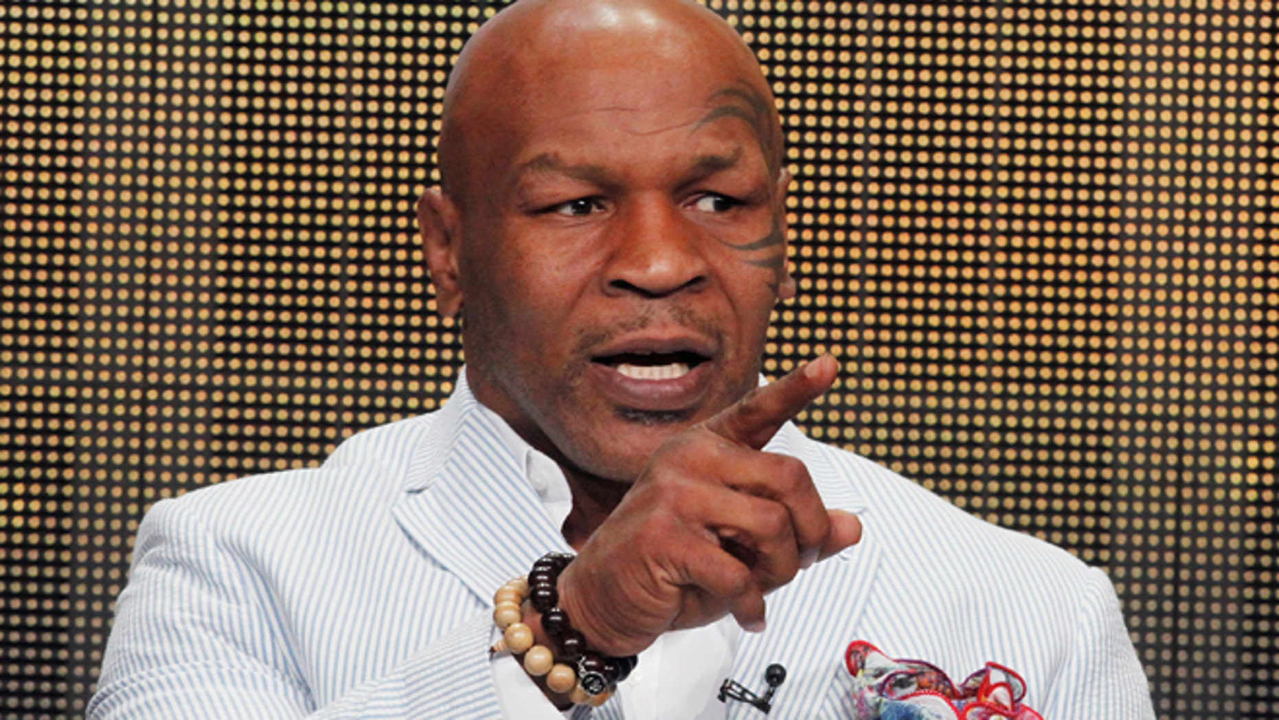 """Mike Tyson, star of HBO Films """"Mike Tyson: Undisputed Truth"""", takes part in a panel discussion at the Television Critics Association Cable TV Summer press tour in Beverly Hills, California July 25, 2013."""