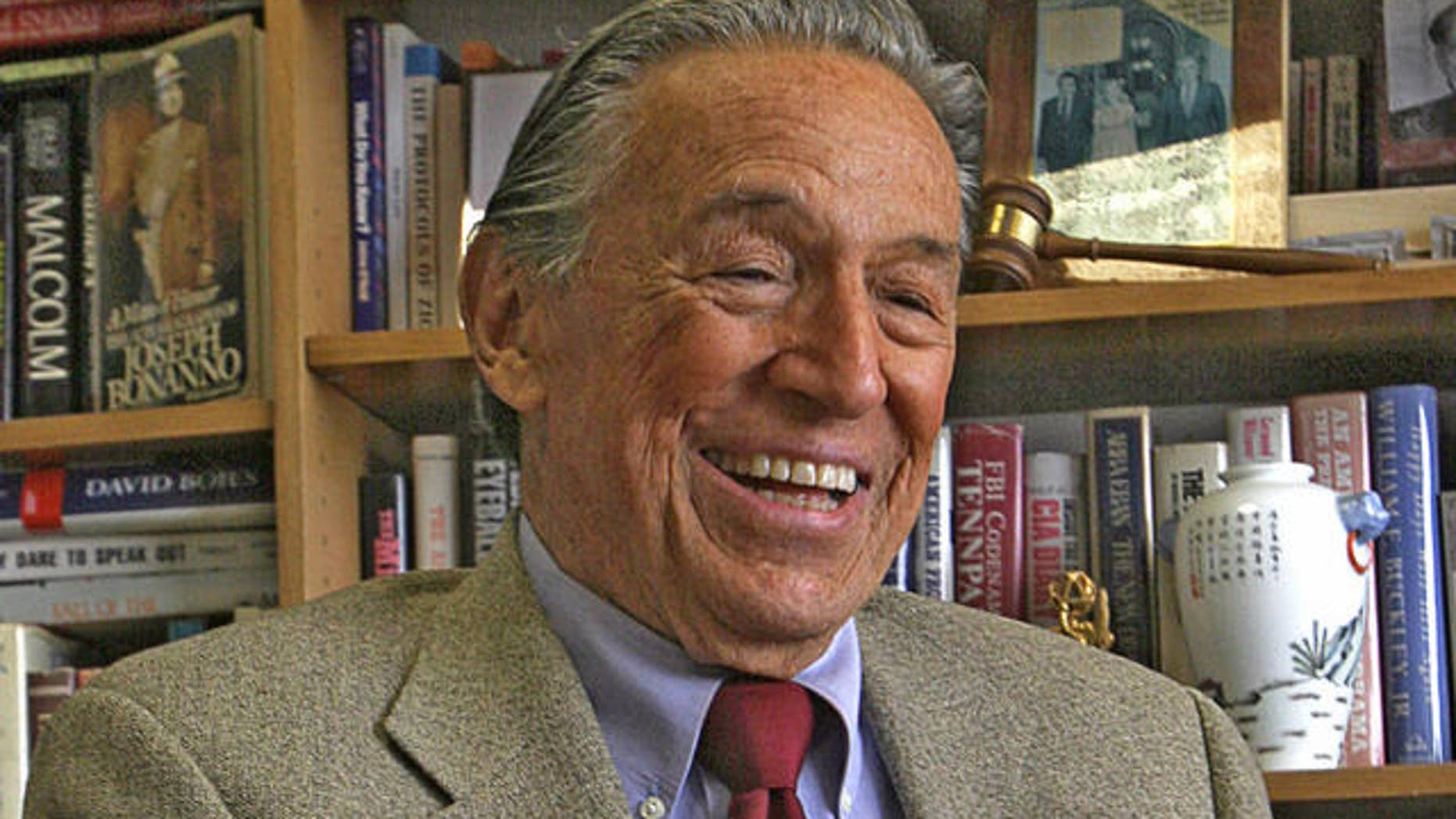 Mike Wallace, 60 Minutes correspondent, laughs during an interview at his office in New York, Monday May 8, 2006.