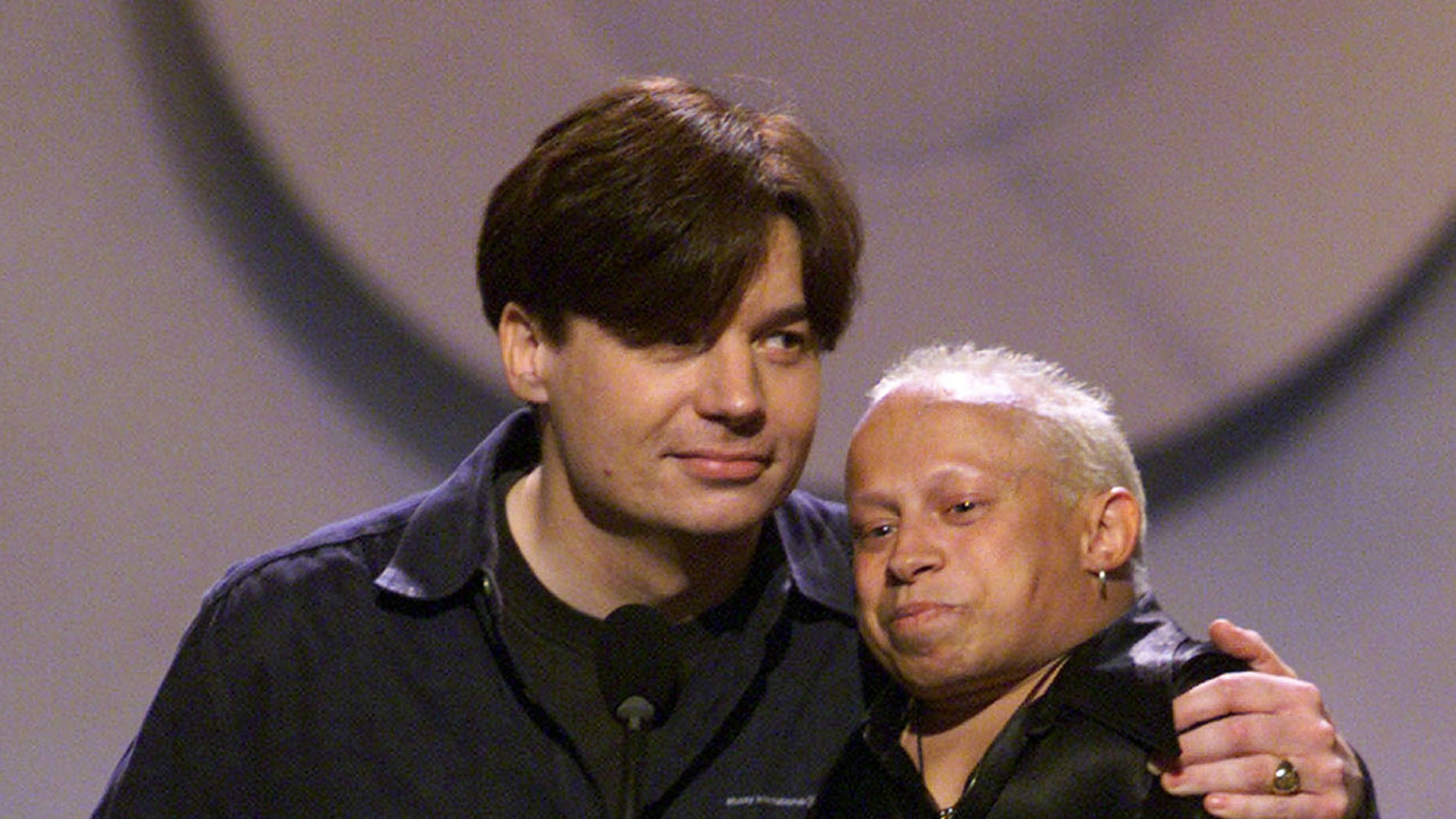 Mike Myers and Verne Troer accept an MTV Movie Award.