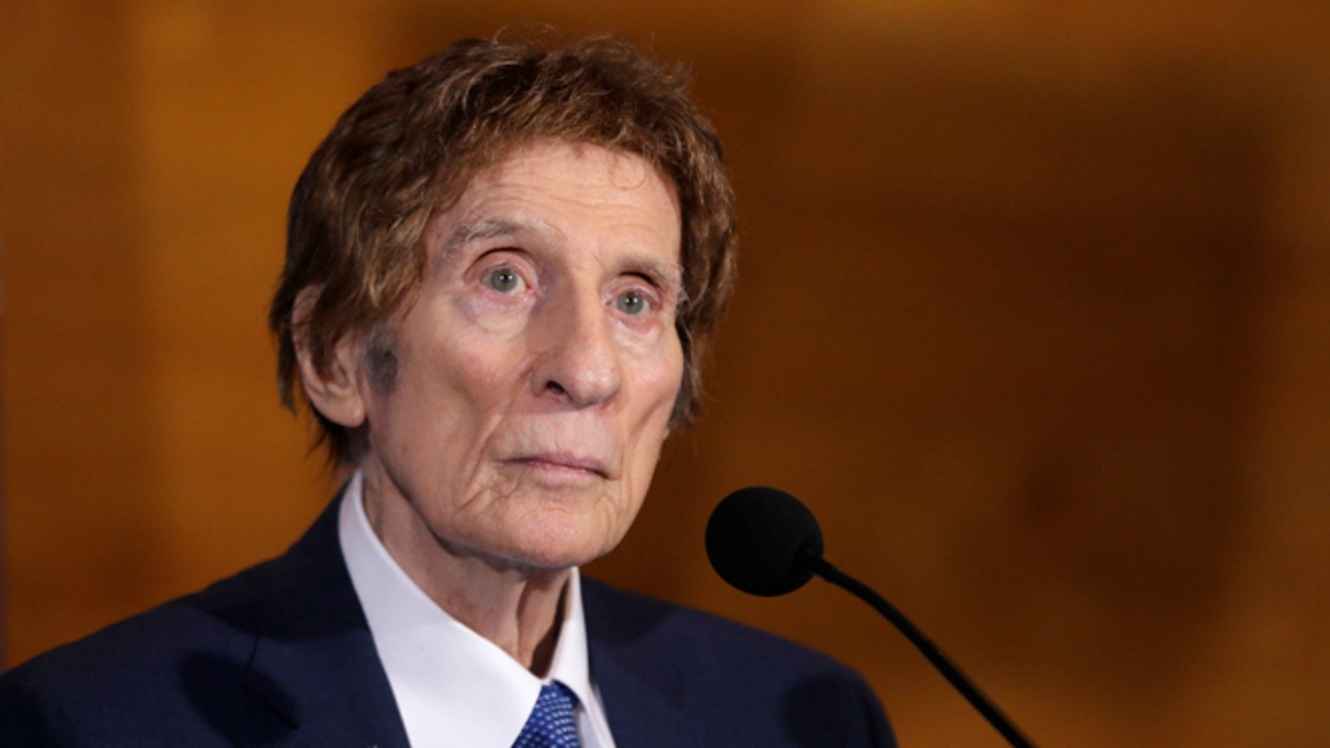 FILE- In a file photo from Nov. 14, 2014, Detroit Tigers owner Mike Ilitch listens during a news conference in Detroit. Ilitch, the owner of the Detroit Red Wings and Tigers, who founded the Little Caesars Pizza empire, has died.