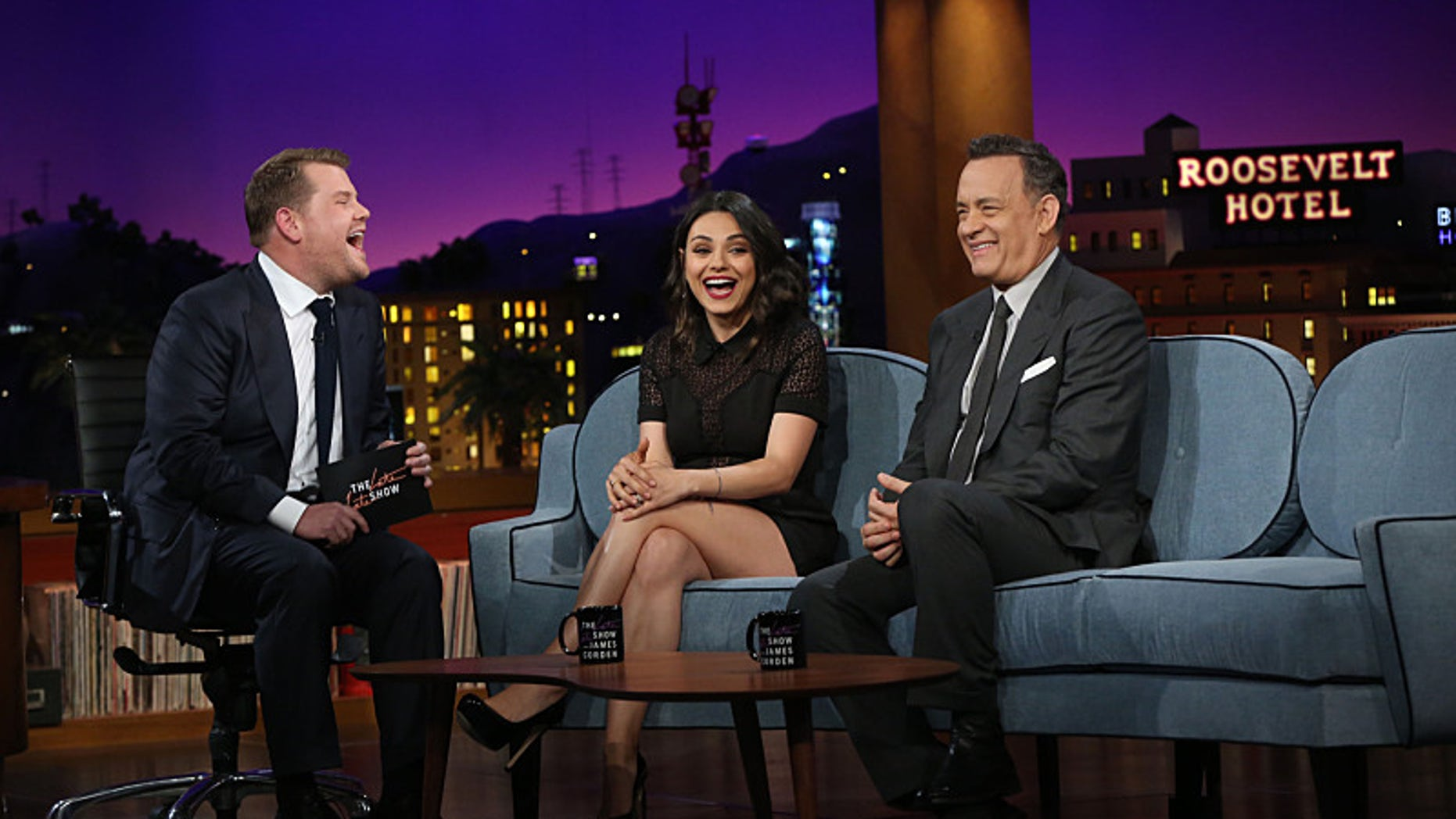 "James Corden chats with his first guests, Tom Hanks and Mila Kunis, on ""The Late Late Show with James Corden."""