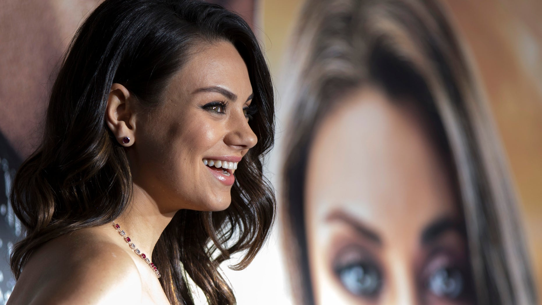 """February 2, 2015. Cast member Mila Kunis poses at the premiere of """"Jupiter Ascending"""" at the TCL Chinese theatre in Hollywood, California."""
