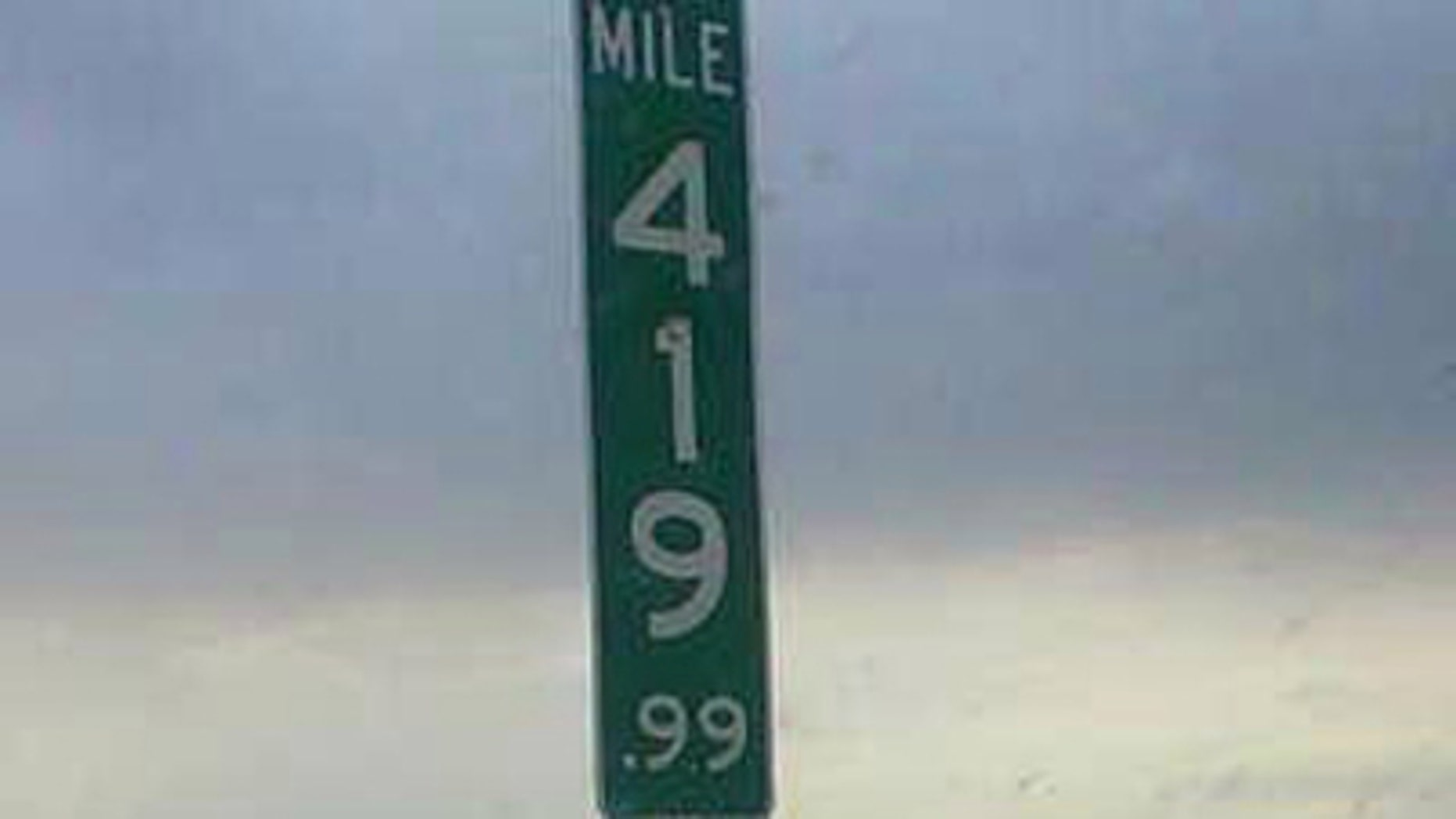 This undated photo shows the new 419.99 mile marker that replaces the 420 mile marker after multiple thefts.