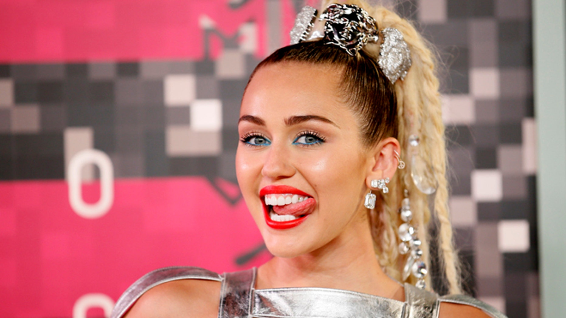 August 30, 2015. Singer and show host Miley Cyrus arrives at the 2015 MTV Video Music Awards in Los Angeles, California.