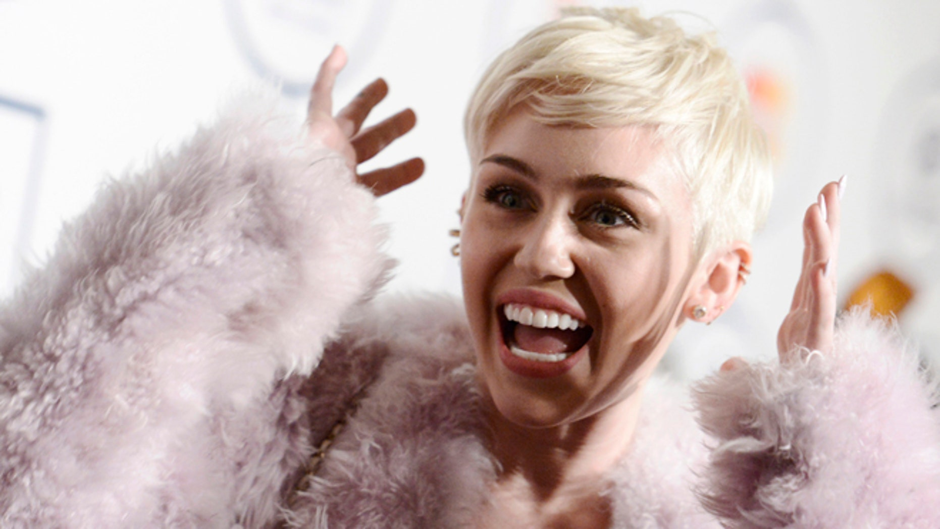 Jan. 25, 2014: Miley Cyrus arrives at the 56th annual Grammy awards.