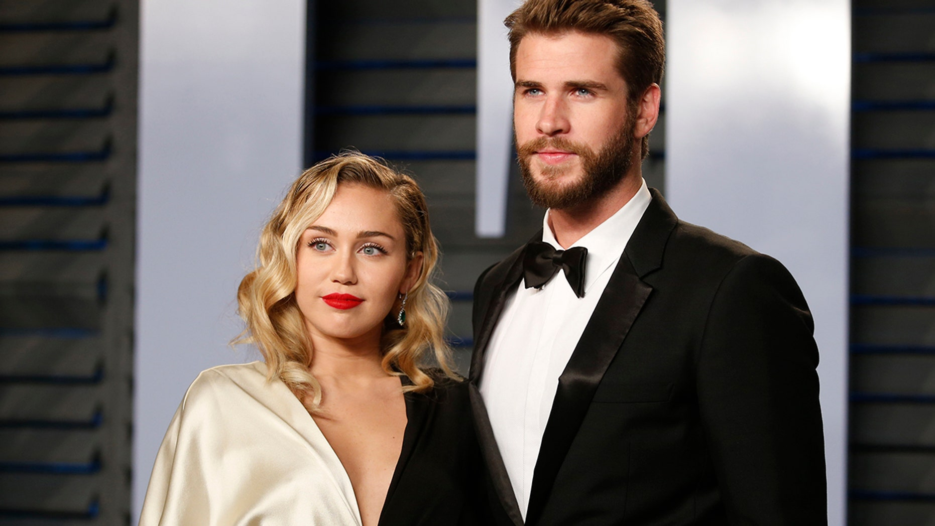 Miley Cyrus and Liam Hemsworth arrive at the 2018 Vanity Fair Oscar Part on March 04, 2018.
