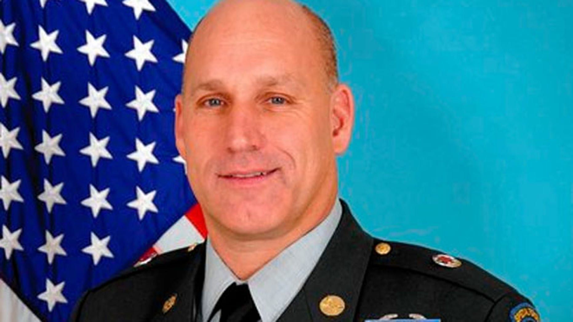 Sgt. Maj. Richard Erickson, 50, says he was fired from the U.S. Postal Service for taking too much time to serve his country.