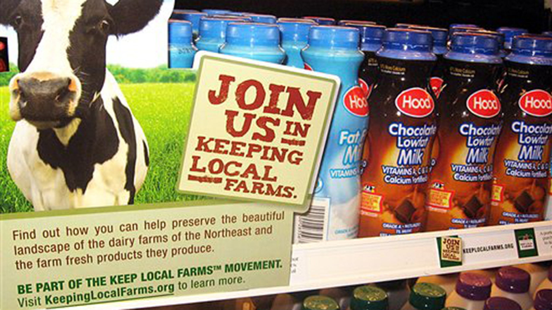 Dec. 17, 2009: Milk is displayed with a Keep Local Farms sign in Burlington, Vt.