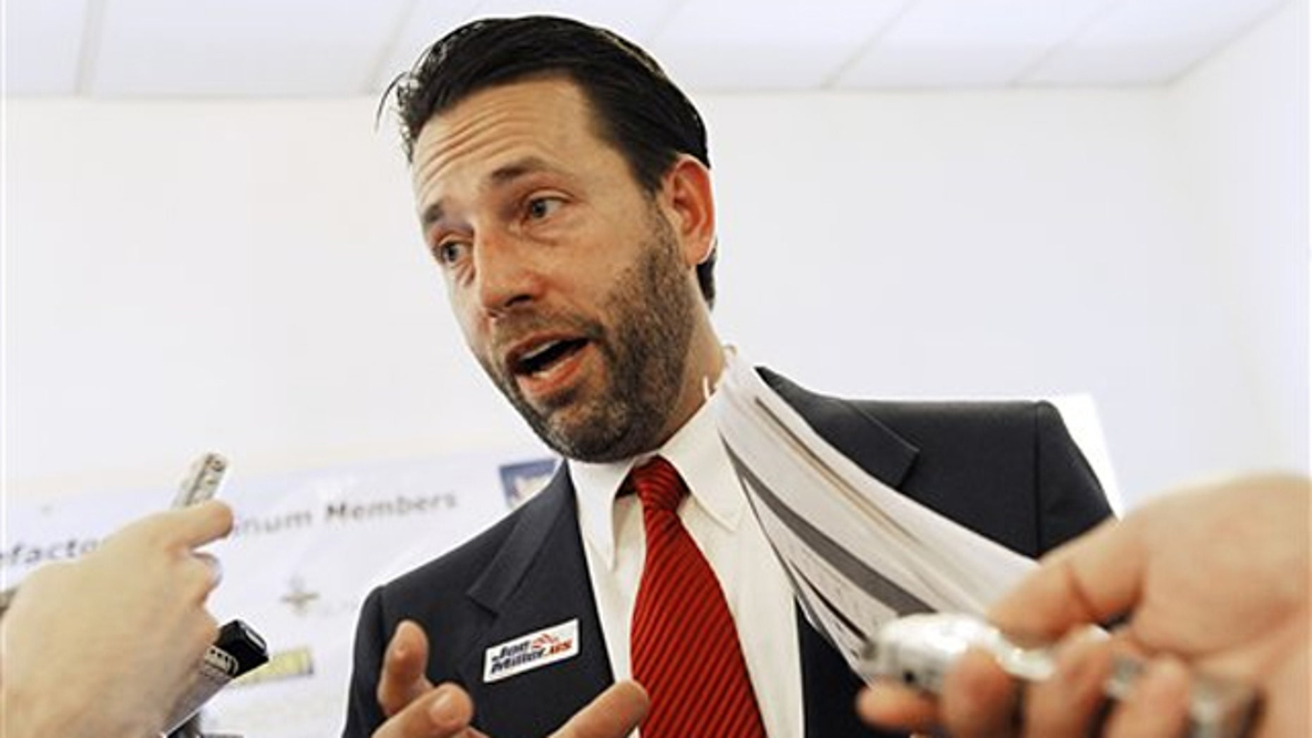In this Sept. 16 photo, Republican Senate candidate Joe Miller answers questions from the media in Juneau, Alaska. (AP Photo)