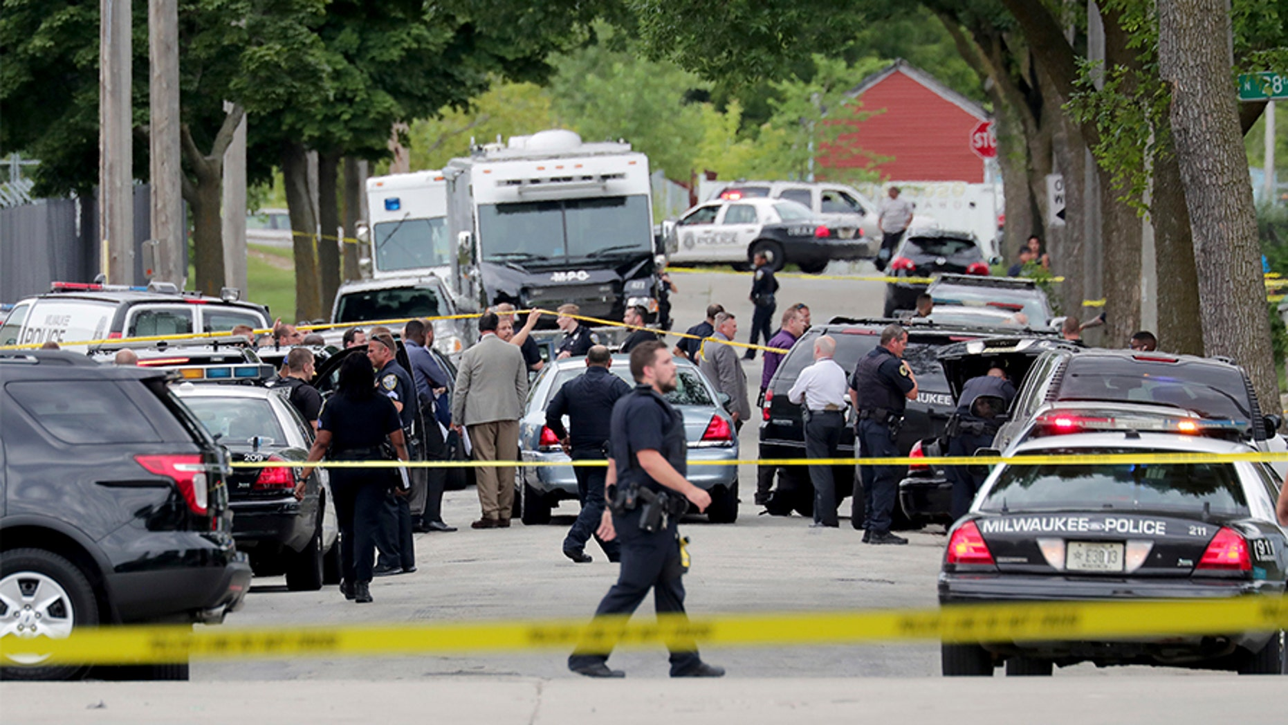 A suspect was reportedly apprehended in the shooting death of a Milwaukee cop.