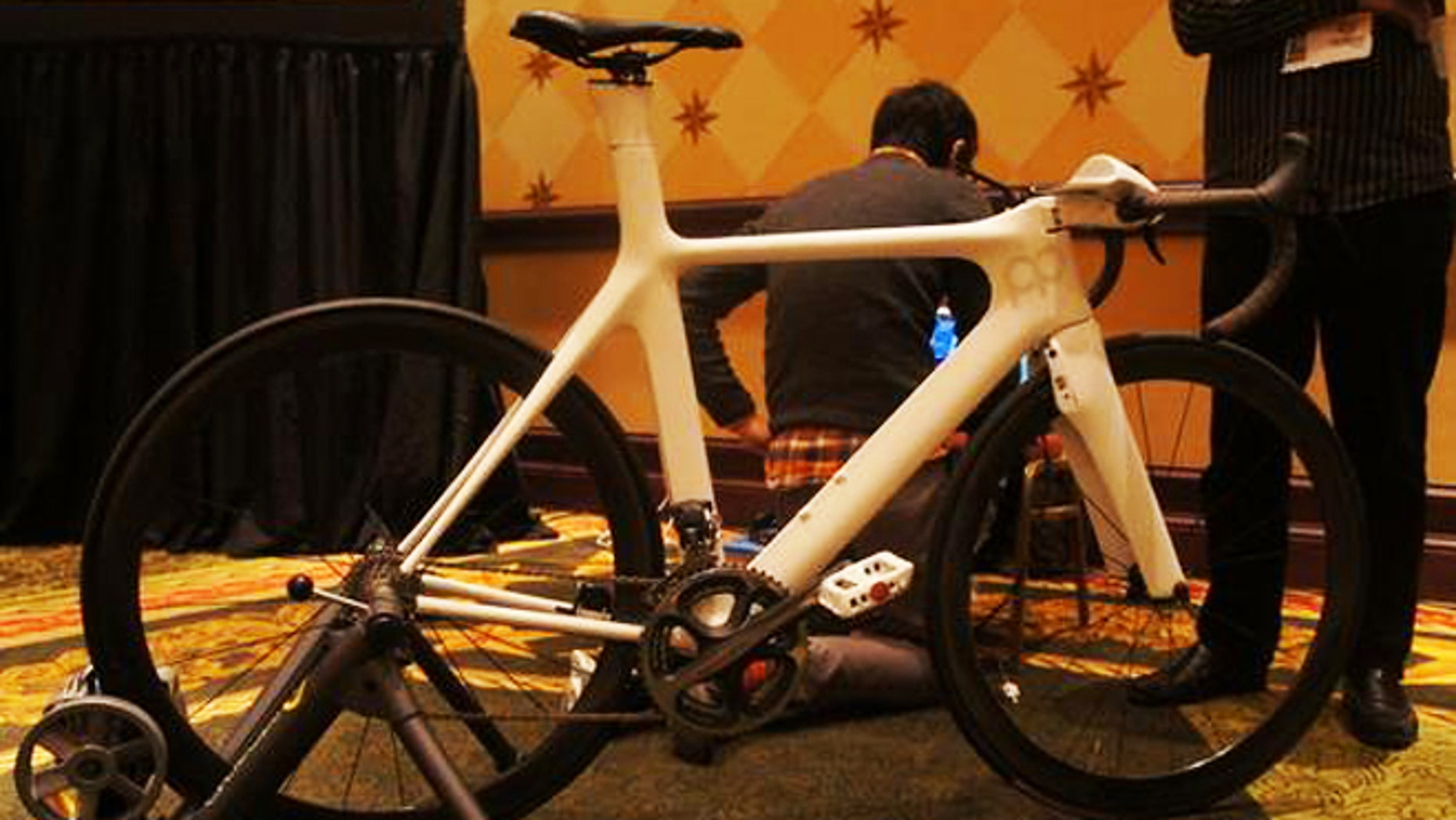 The Prius Bike at South by Southwest 2012, with engineer Patrick Miller in the background.