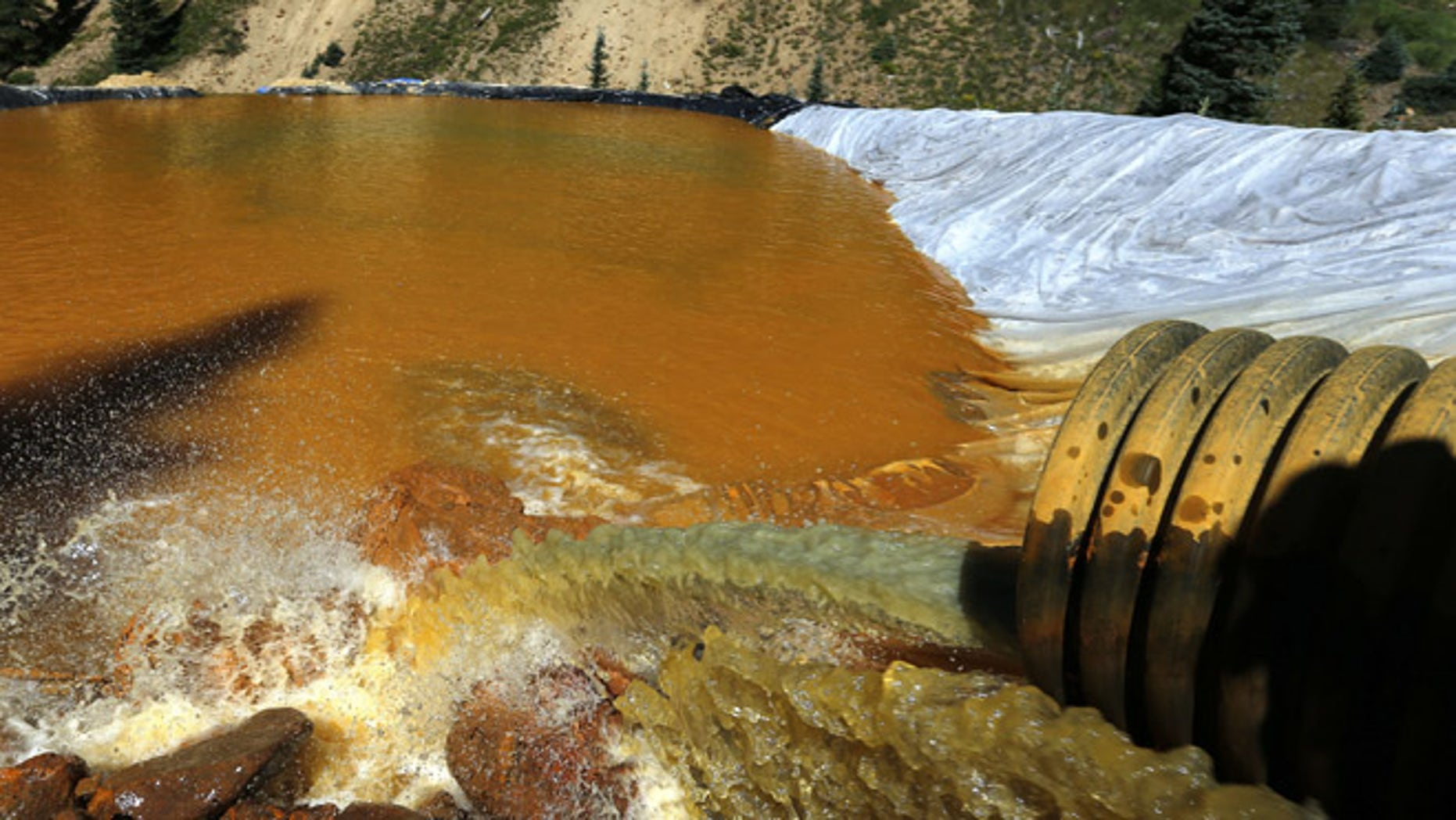 Aug. 14, 2015: Water flows through a series of sediment retention ponds built to reduce heavy metal and chemical contaminants from the Gold King Mine wastewater accident, in the spillway about 1/4 mile downstream from the mine, outside Silverton, Colo.