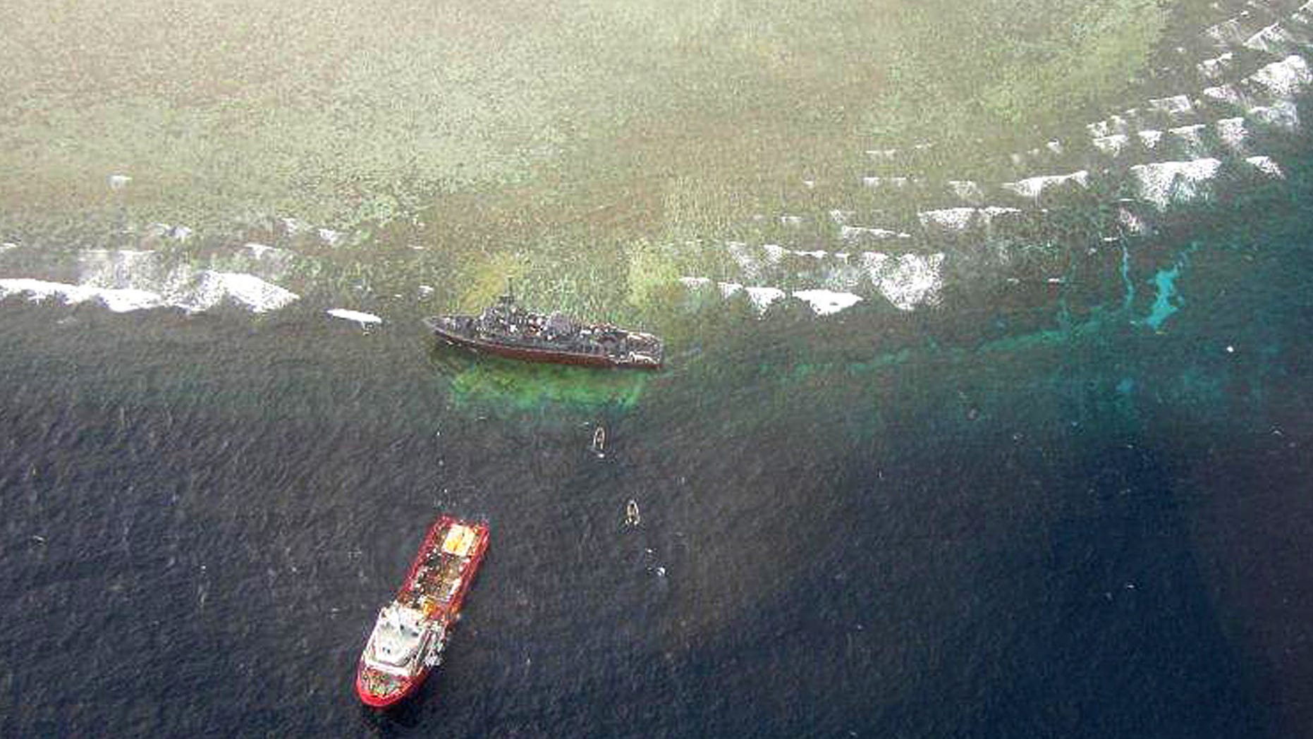 Aerial view of the U.S. Navy minesweeper USS Guardian stranded in the Tubbataha Reef, a World Heritage Site in the Sulu Sea. (AP)