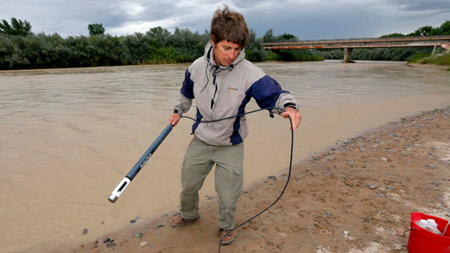 Aug. 11, 2015: Ben Brown, with the Utah Department of Environmental Quality, takes a pH level reading from a probe in the San Juan River Montezuma Creek, Utah.