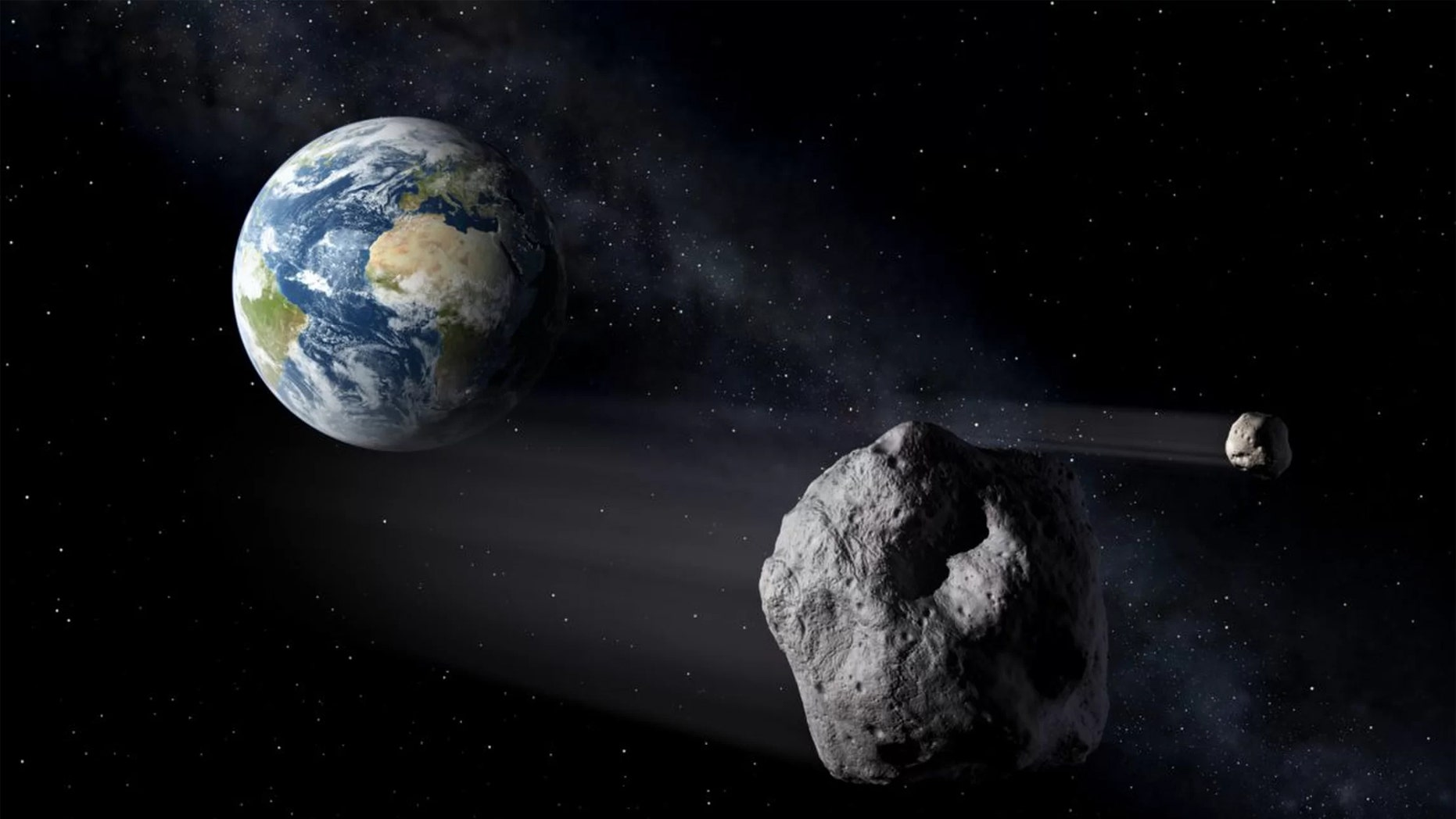 """Earth is surrounded by a host of asteroids, some of which may temporarily become """"minimoons."""" Credit: P. Carril/NASA"""