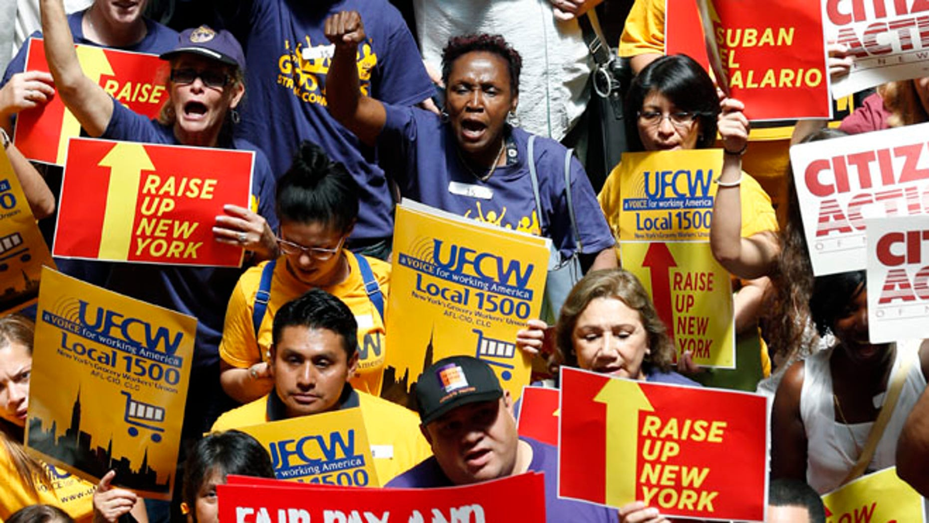 FILE: June 17, 2014: Protesters rally for an increase in the minimum wage on the Great Western Staircase at the capitol, in Albany, N.Y.