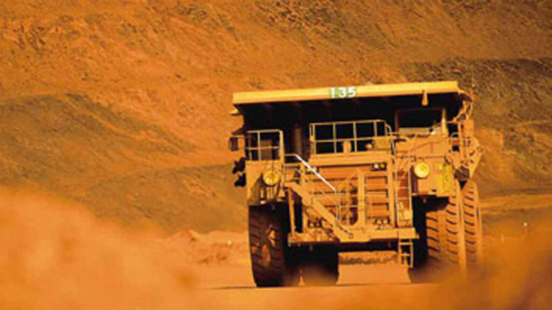 Truckers and train drivers who haul iron ore in Australia's remote Pilbarra region earn an average of $225,000 a year, but the companies that employ them are replacing them with robots. (Handout: BHP Billiton)