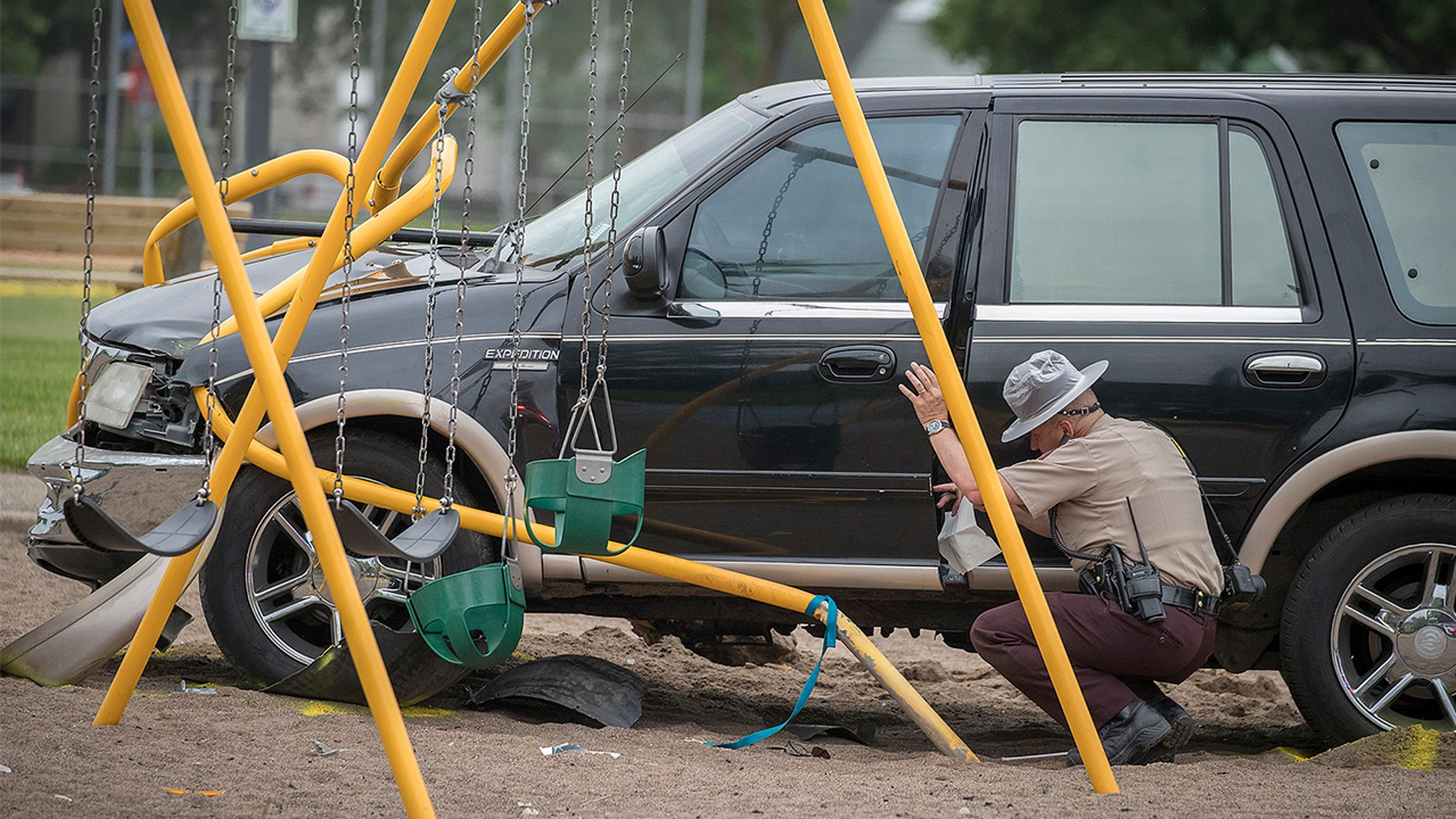 Minnesota State Patrol investigates the scene where a motorist being pursued by the State Patrol veered into a Minneapolis playground on Monday.