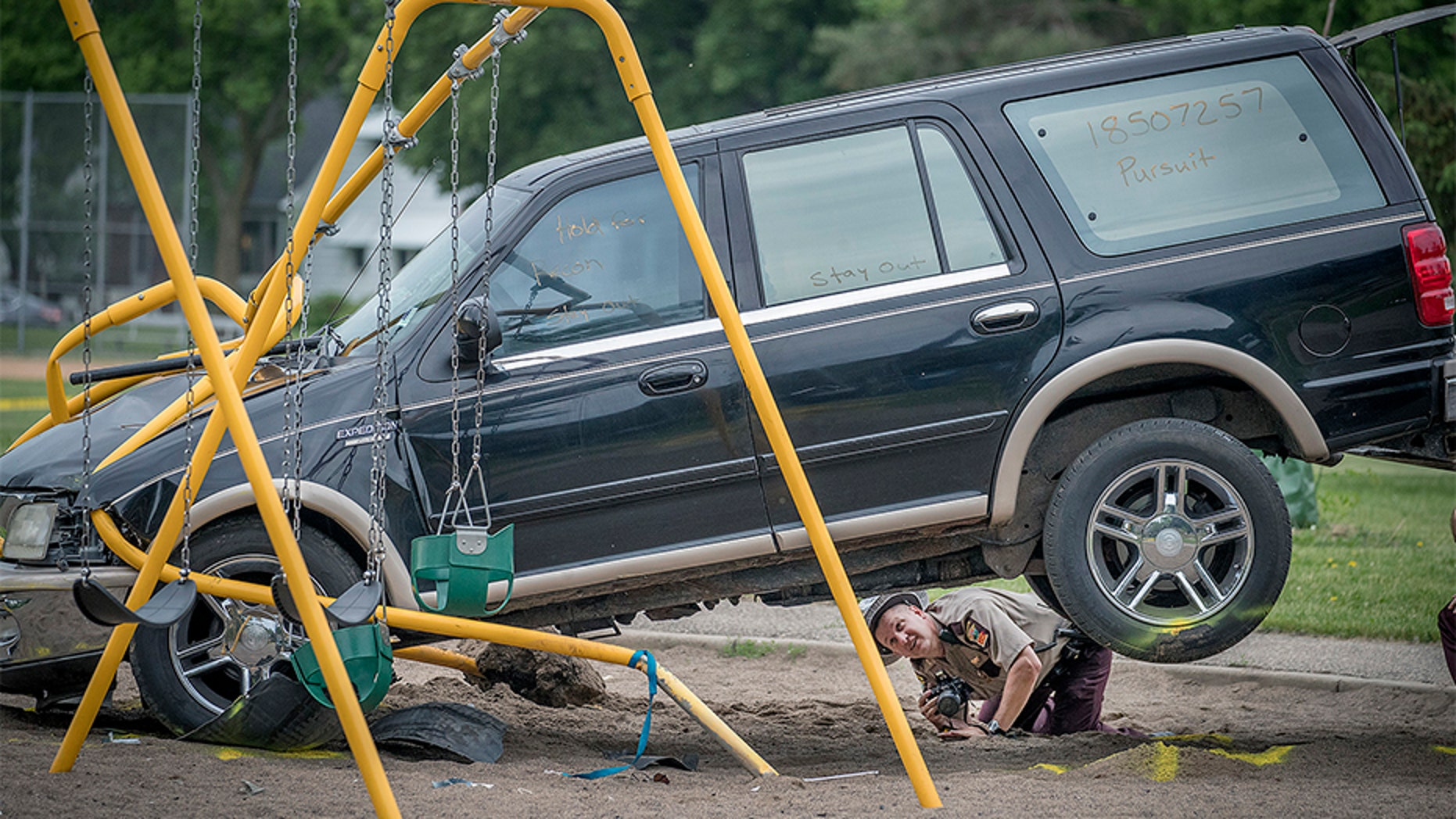 June 11, 2018: Minnesota State Patrol investigates the scene where a driver being pursued by the State Patrol veered into a Minneapolis school playground.