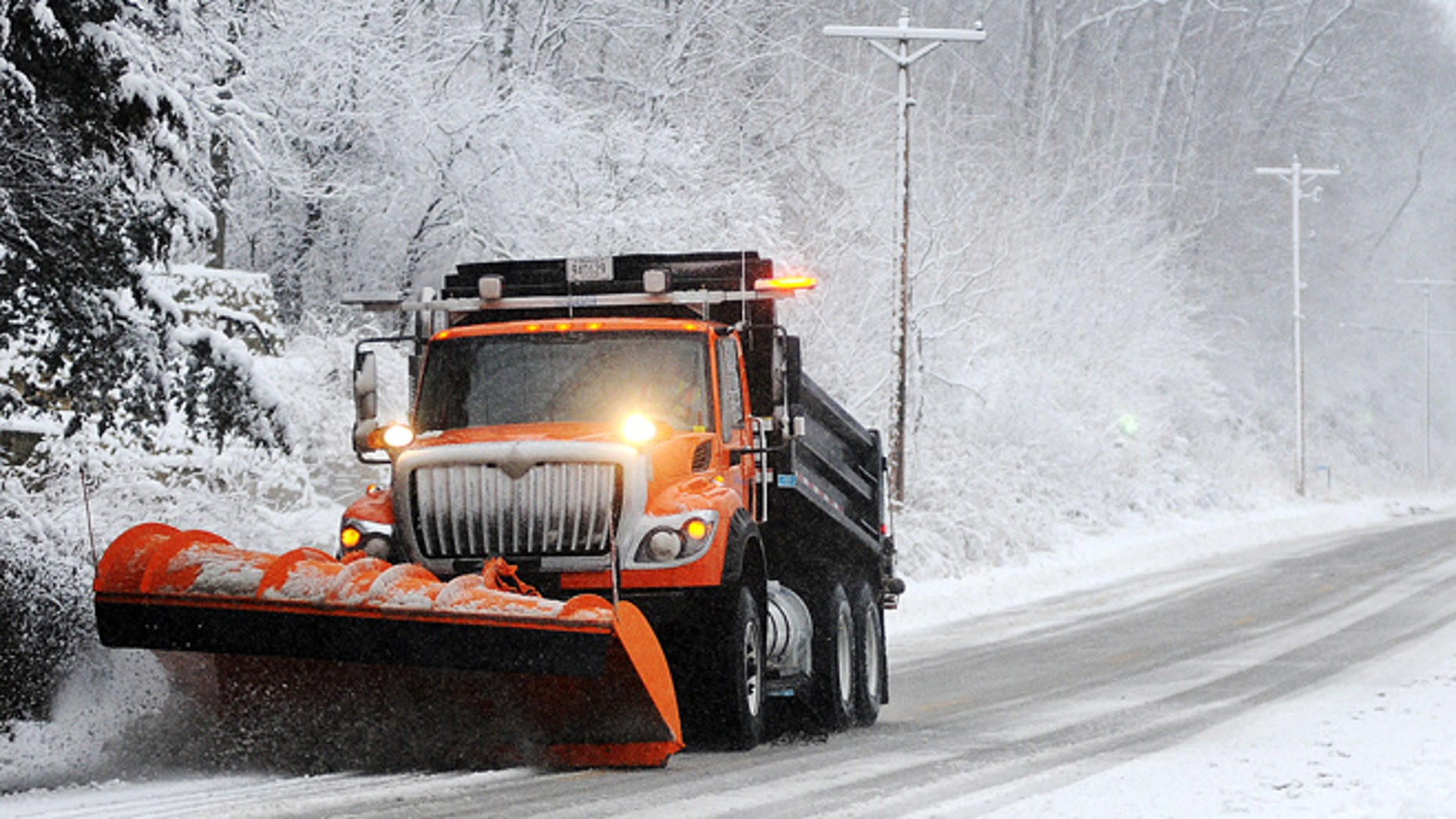 Dec. 9, 2012: A snow plow clears off Old Homer Road, near Winona, Minn. The National Weather Service is predicting a total accumulation of five to 10 inches by Monday morning.