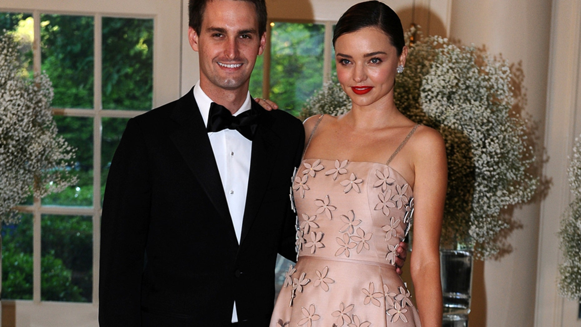 File photo: Evan Spiegel, Chief Executive Officer, Snapchat and model Miranda Kerr arrive for the state dinner in honor of the Nordic Summit at the White House in Washington, May 13, 2016.  (Reuters)