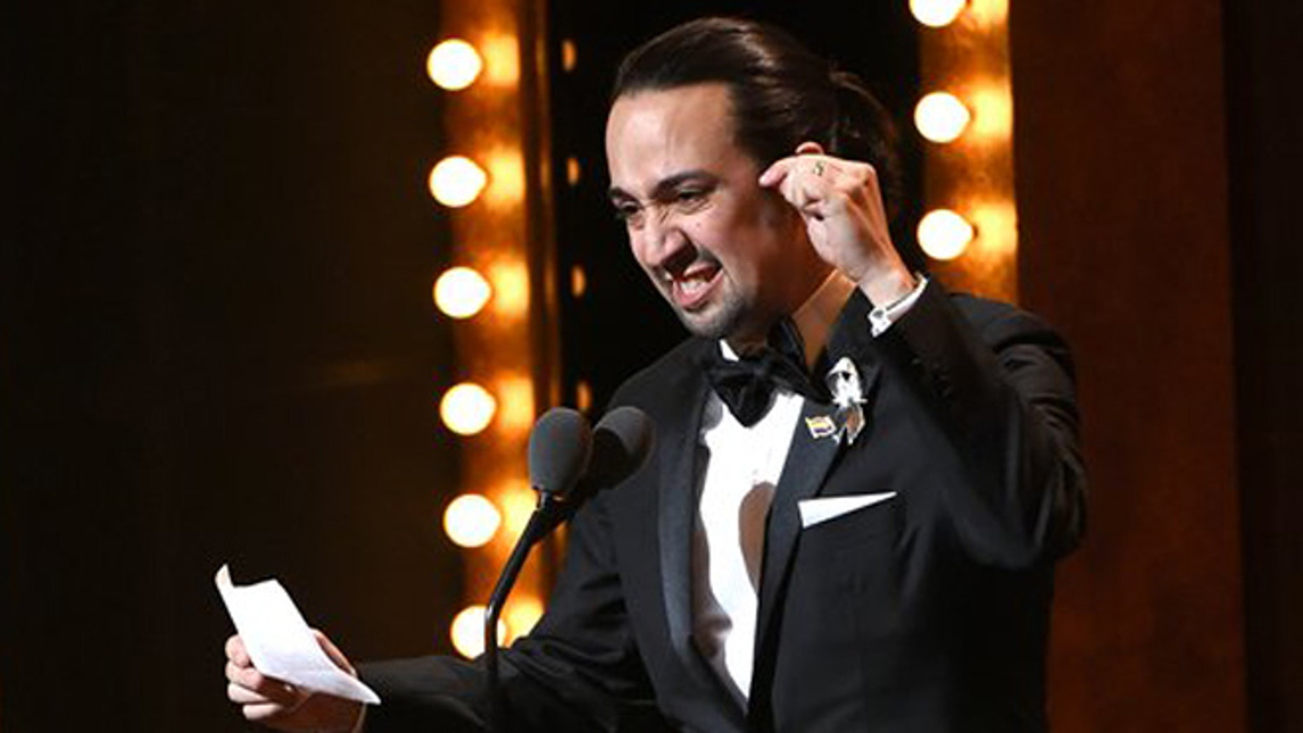 """Lin-Manuel Miranda accepts the award for best original  score for  """"Hamilton"""" at the Tony Awards at the Beacon Theatre on Sunday, June 12, 2016, in New York. (Photo by Evan Agostini/Invision/AP)"""