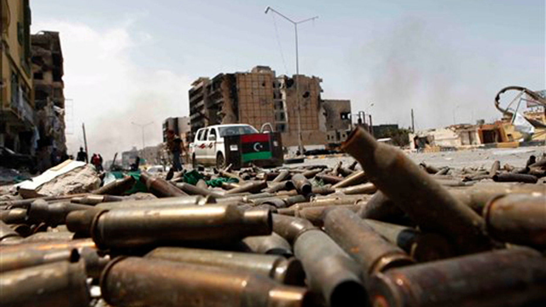 In this April 23 file photo, bullet casings litter a street in the besieged city of Misrata, Libya.