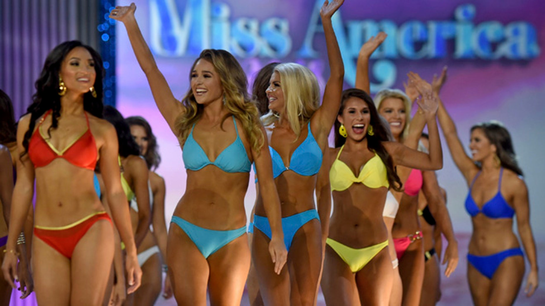 Contestants greet onstage in the swimsuit competition during the first night of Miss America 2018 preliminaries in Atlantic City.