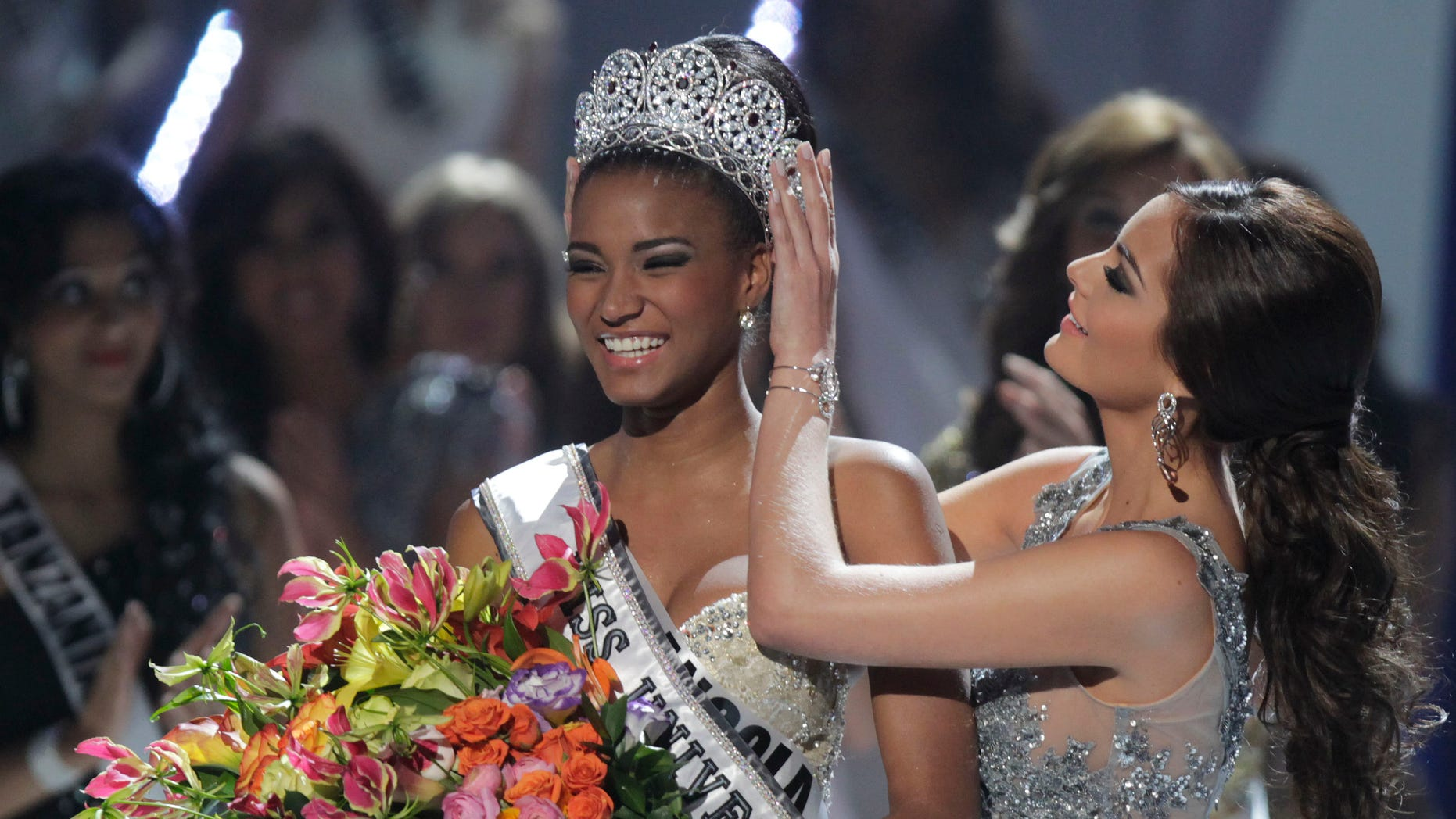 Sept. 12: Miss Angola Leila Lopes, left, is crowned Miss Universe 2011 by Miss Universe 2010 Ximena Navarrete, of Mexico, in Sao Paulo, Brazil.