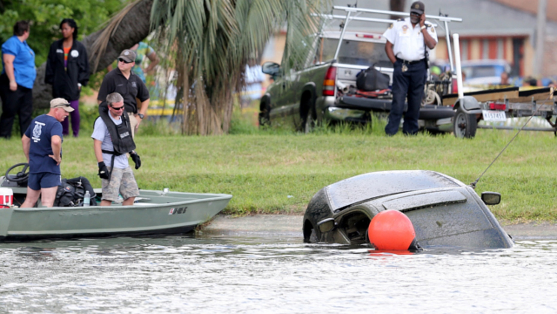 June 8, 2013: The Honda Accord belonging to teacher Terrilynn Monette, who has been missing since leaving a nearby bar in early March, is pulled from Bayou St. John by the Harrison Avenue Bridge in New Orleans.