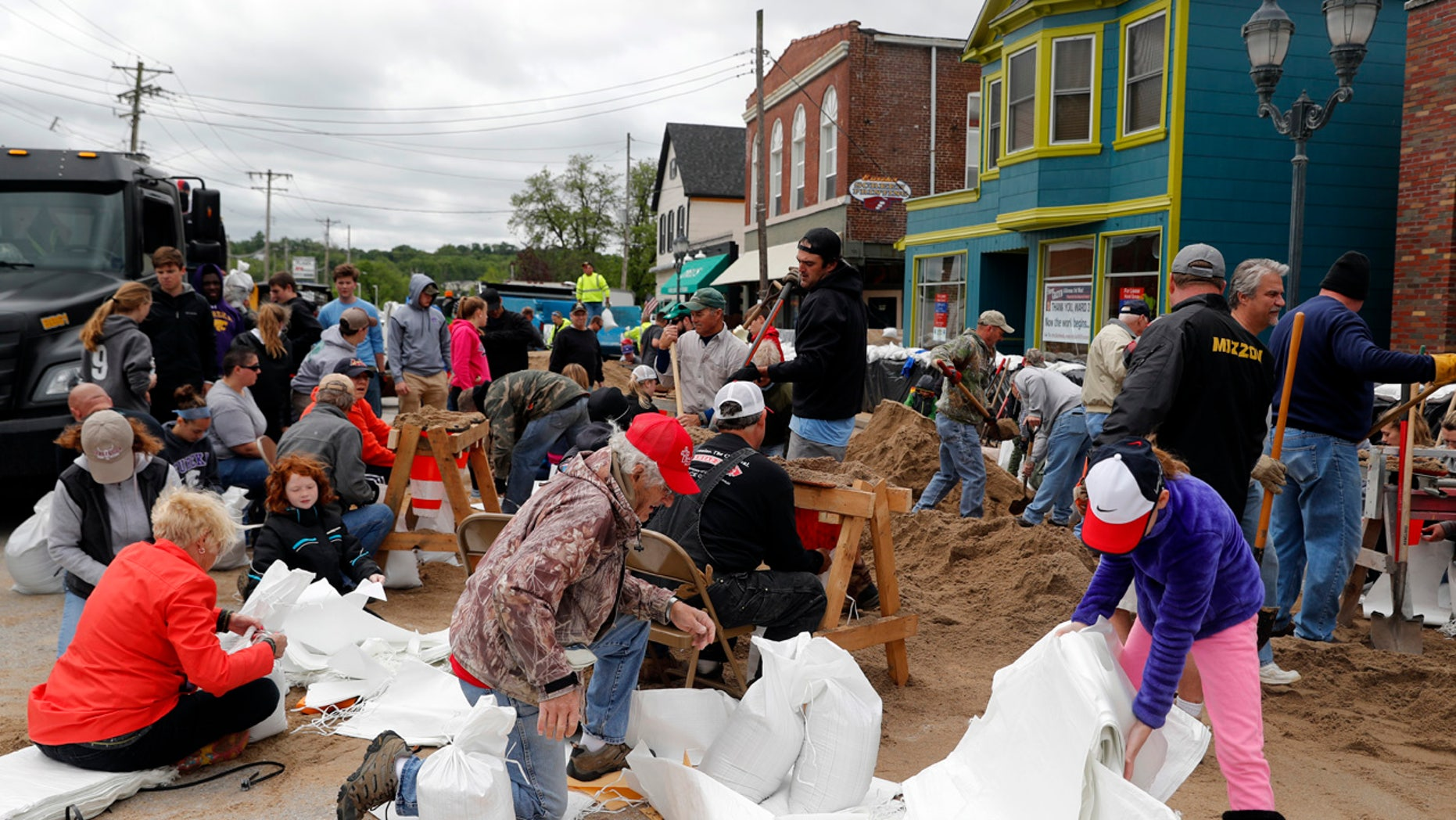 Volunteers fill sandbags in an effort to protect buildings from potential floodwater Monday, May 1, 2017, in Eureka, Mo.