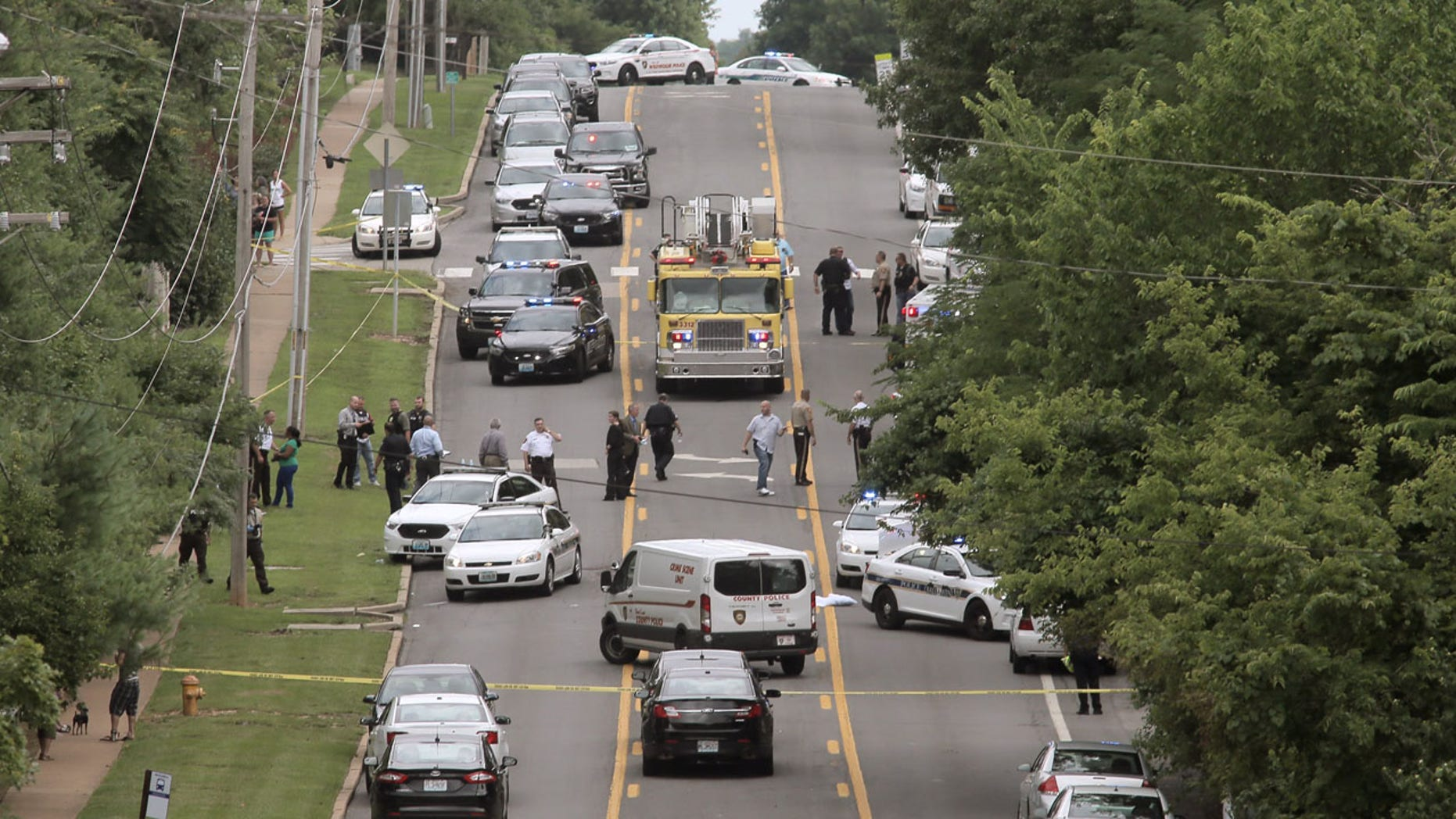 July 8, 2016: Police investigate a scene in Ballwin, Mo. after a police officer was shot during a confrontation with a man on a street.