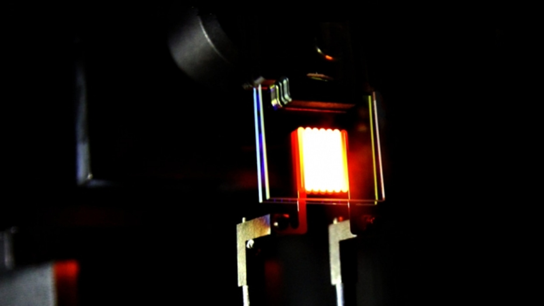 A proof-of-concept device built by MIT researchers demonstrates the principle of a two-stage process to make incandescent bulbs more efficient. This device already achieves efficiency comparable to some compact fluorescent and LED bulbs.  (MIT researchers)