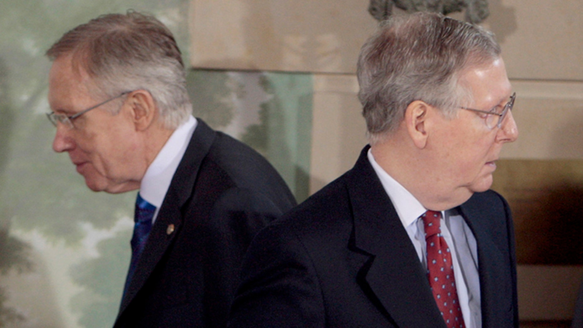 In this Feb. 25, 2010, file photo Senate Majority Leader Harry Reid of Nev., left, walks past Senate Minority Leader Mitch McConnell of Ky., during a meeting at the Blair House in Washington. Reid has promised he will not let GOP's health care repeal effort come up for debate on Senate floor, while McConnell says the Senate will vote on a bill to repeal ObamaCare.
