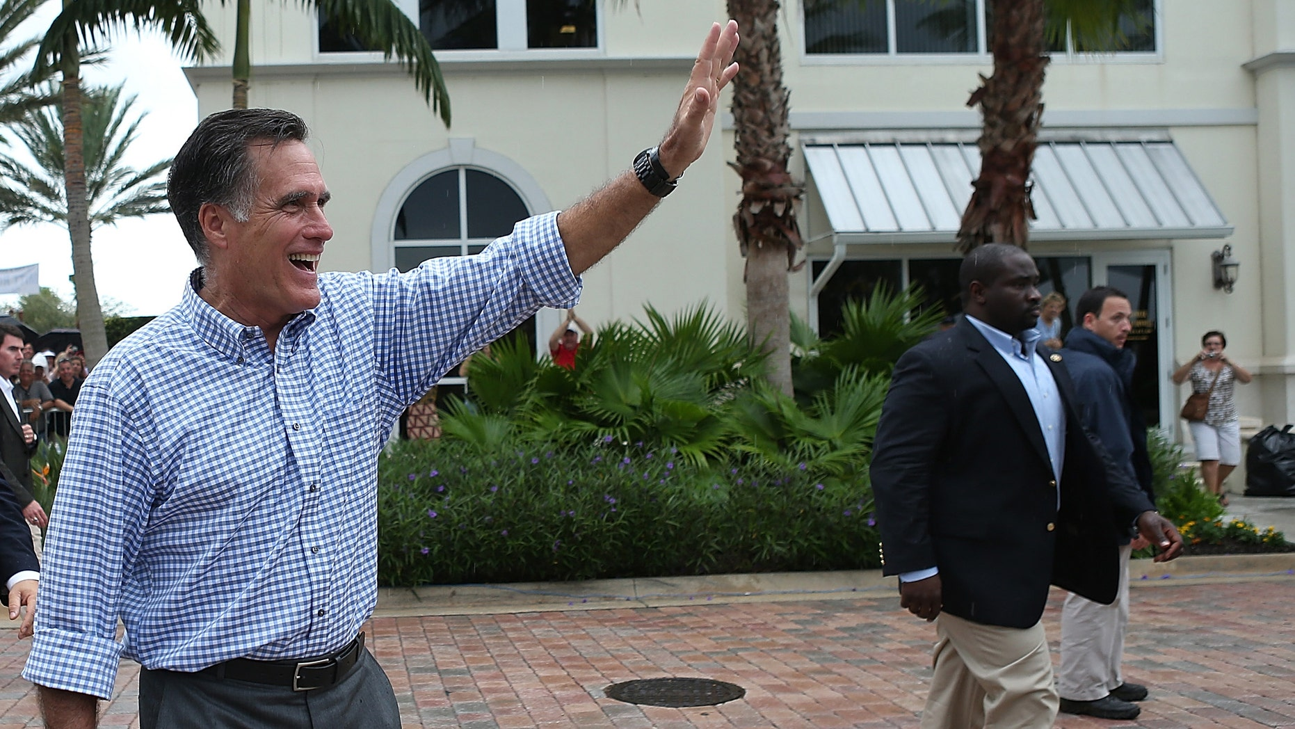 Republican presidential candidate Mitt Romney waves to supporters after a victory rally at Tradition Town Square on October 7, 2012 in Port St. Lucie, Florida.