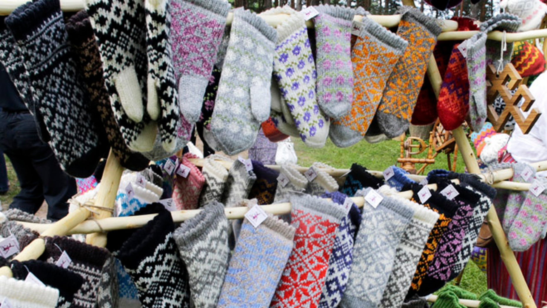 Traditional knitted mittens are displayed during an annual Traditional Applied Arts Fair in the Ethnographic Open-air Museum of Latvia in Riga, June 1, 2013. According to the organisers, the fair has more than 500 tailors, leather craftsmen, wood carvers, jewellery designers, blacksmiths, basket-makers, weavers, potters, as well as knitters from all over Latvia who will be selling their crafts from June 1 to 2. REUTERS/Ints Kalnins (LATVIA - Tags: SOCIETY TRAVEL) - RTX10864