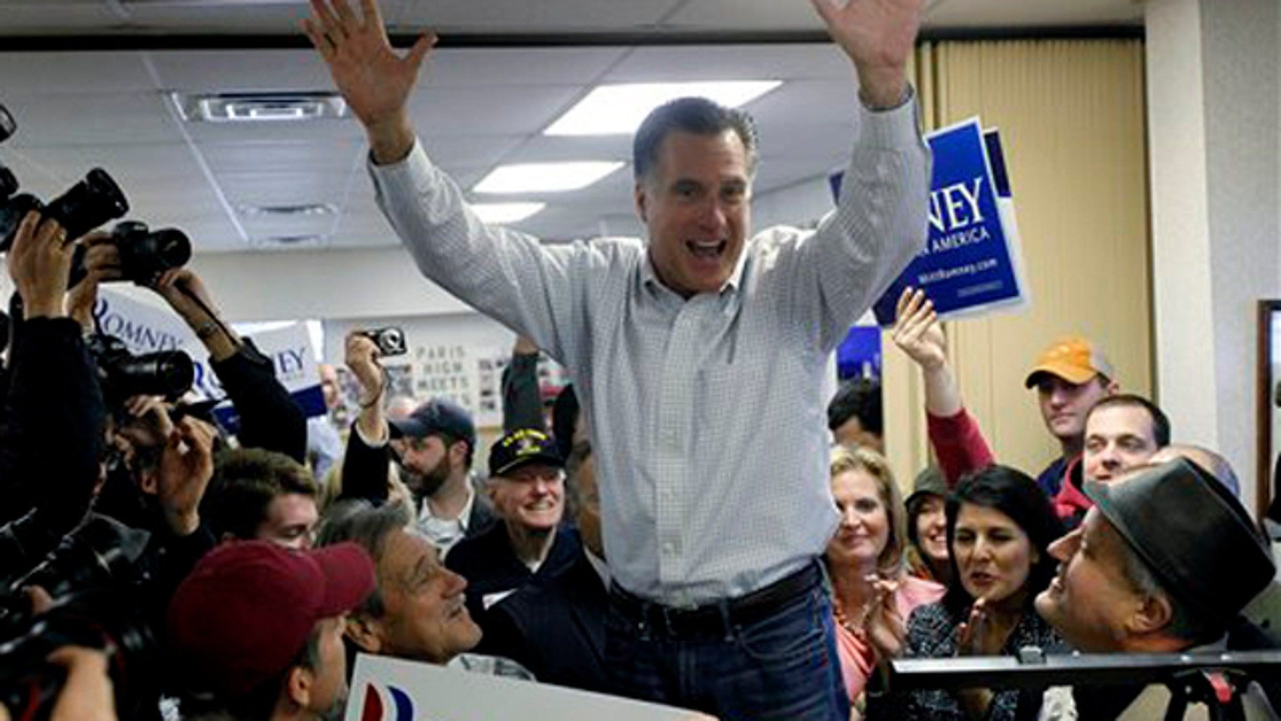 Jan. 21, 2012: Mitt Romney campaigns at Tommy's Country Ham House in Greenville, S.C., on South Carolina's Republican primary election day.