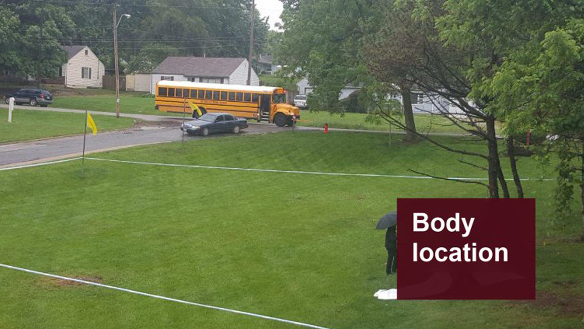 The scene where a body was found in a residential area when the bus of children passed by.