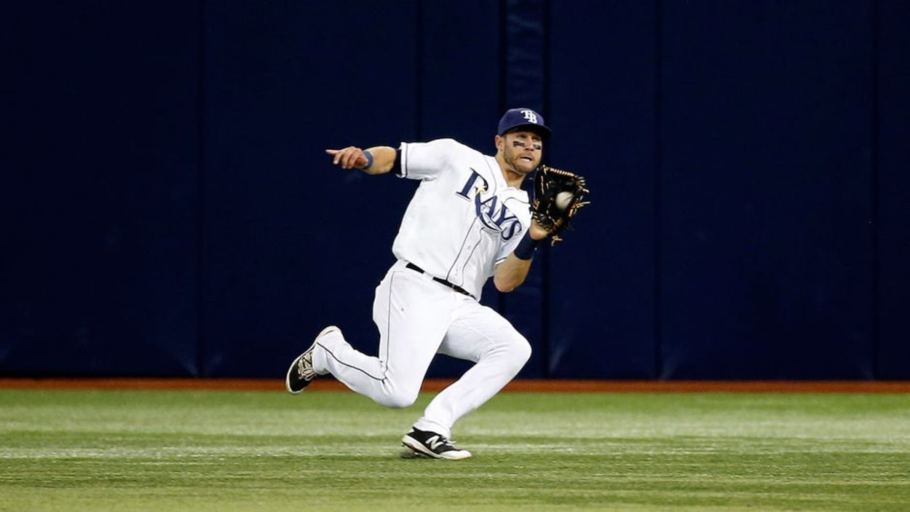 Apr 25, 2016; St. Petersburg, FL, USA; Tampa Bay Rays center fielder Kevin Kiermaier (39) catches a fly ball during the ninth inning against the Baltimore Orioles at Tropicana Field. Tampa Bay Rays defeated the Baltimore Orioles 2-0. Mandatory Credit: Kim Klement-USA TODAY Sports
