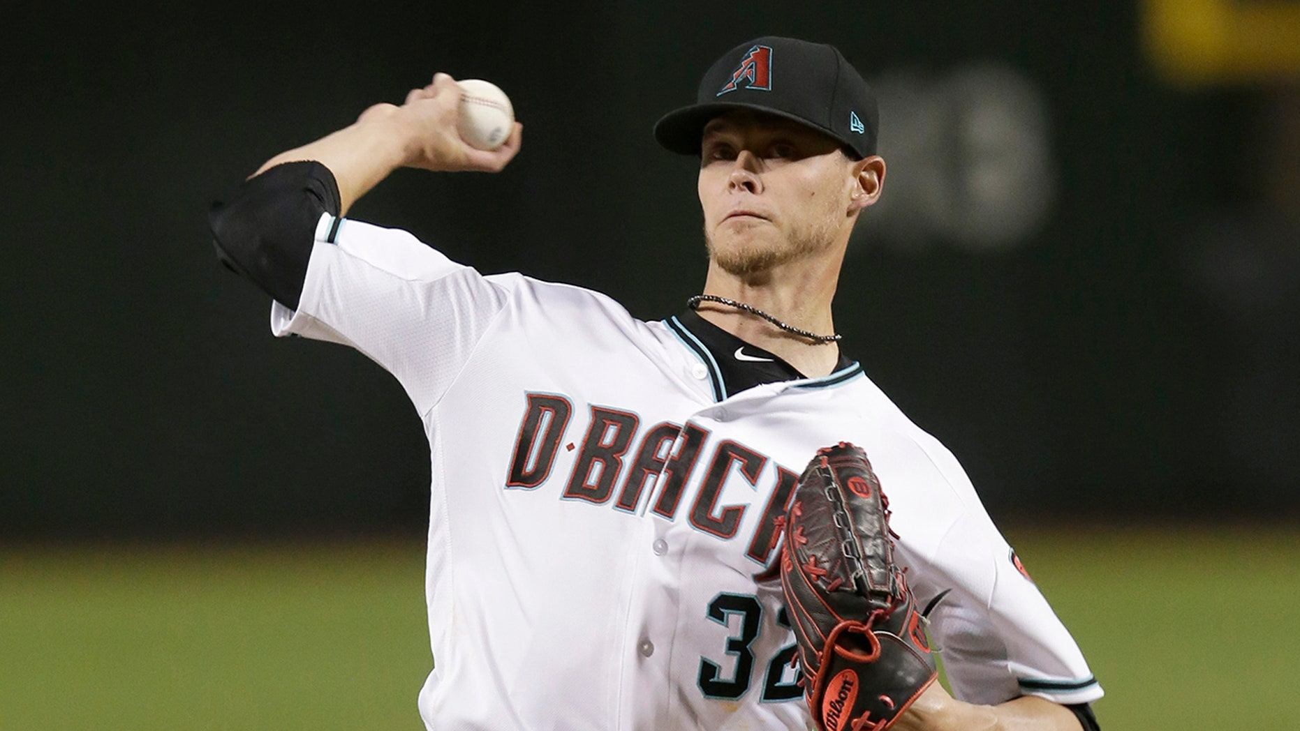 Arizona Diamondbacks pitcher Clay Buchholz throws during the first inning of the team's baseball game against the Pittsburgh Pirates.