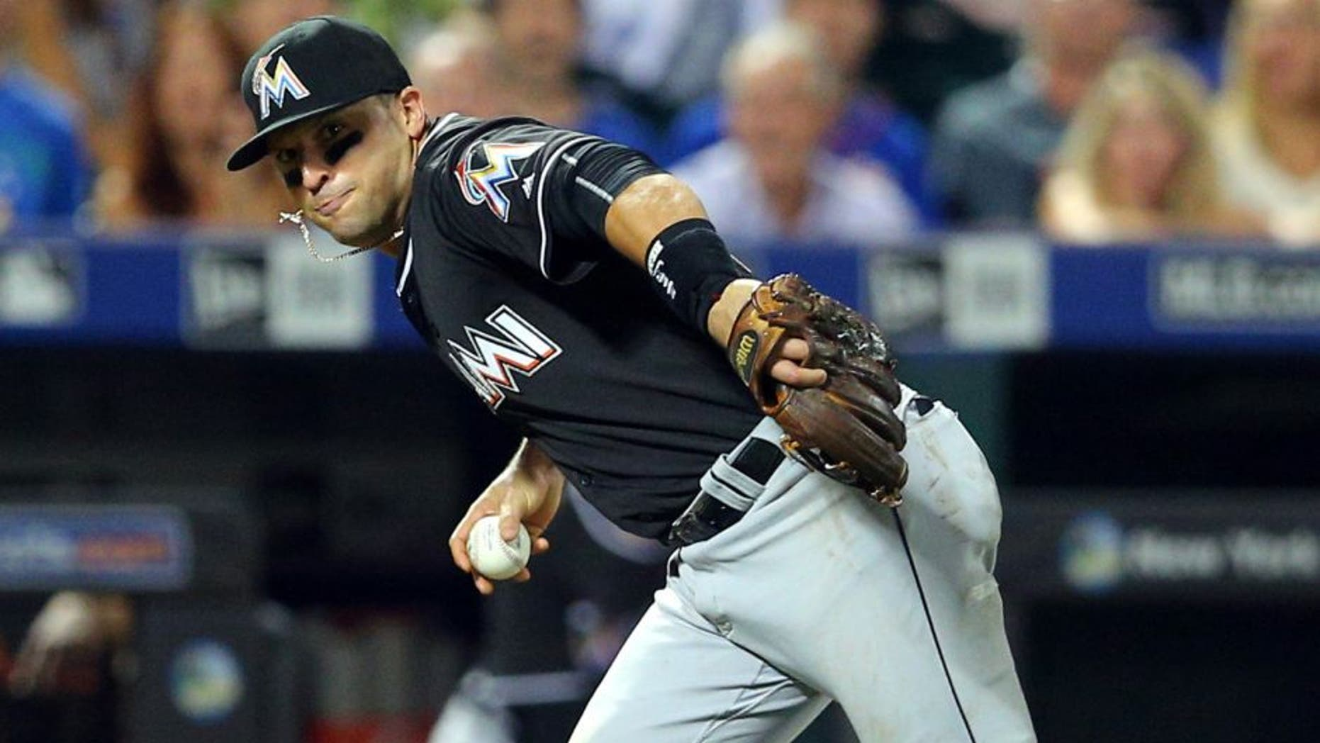 Aug 30, 2016; New York City, NY, USA; Miami Marlins third baseman Martin Prado (14) bare hands a ground ball and throws out New York Mets catcher Rene Rivera (not pictured) to end the fifth inning at Citi Field. Mandatory Credit: Brad Penner-USA TODAY Sports