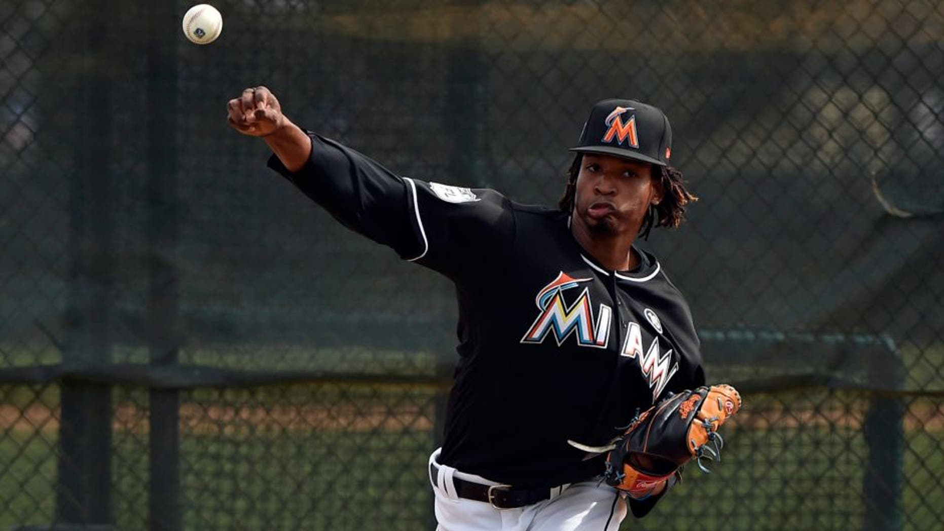 Feb 16, 2017; Ju, FL, USA; Miami Marlins relief pitcher Jose Urena (62) throws during spring training drills at Roger Dean Stadium. Mandatory Credit: Steve Mitchell-USA TODAY Sports