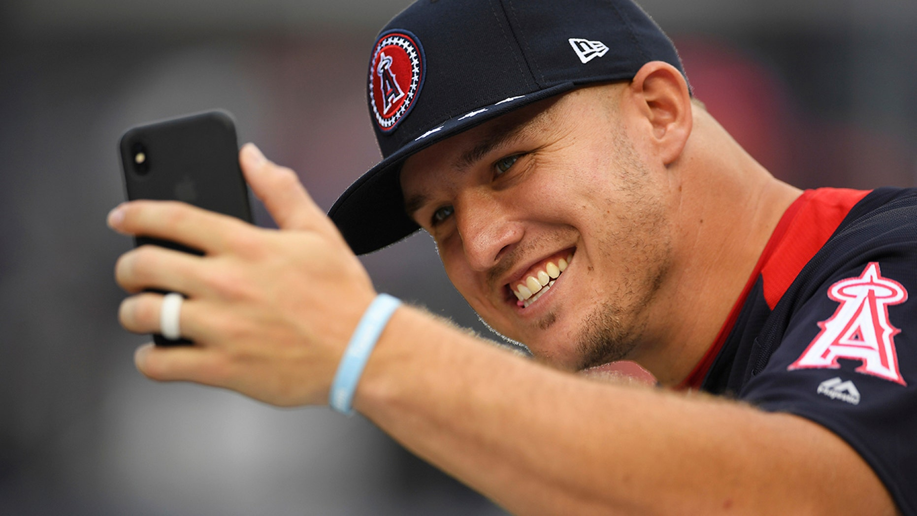 Los Angeles Angels outfielder Mike Trout takes a photo on the field ahead of the Home Run derby during the All-Star Game festivities.