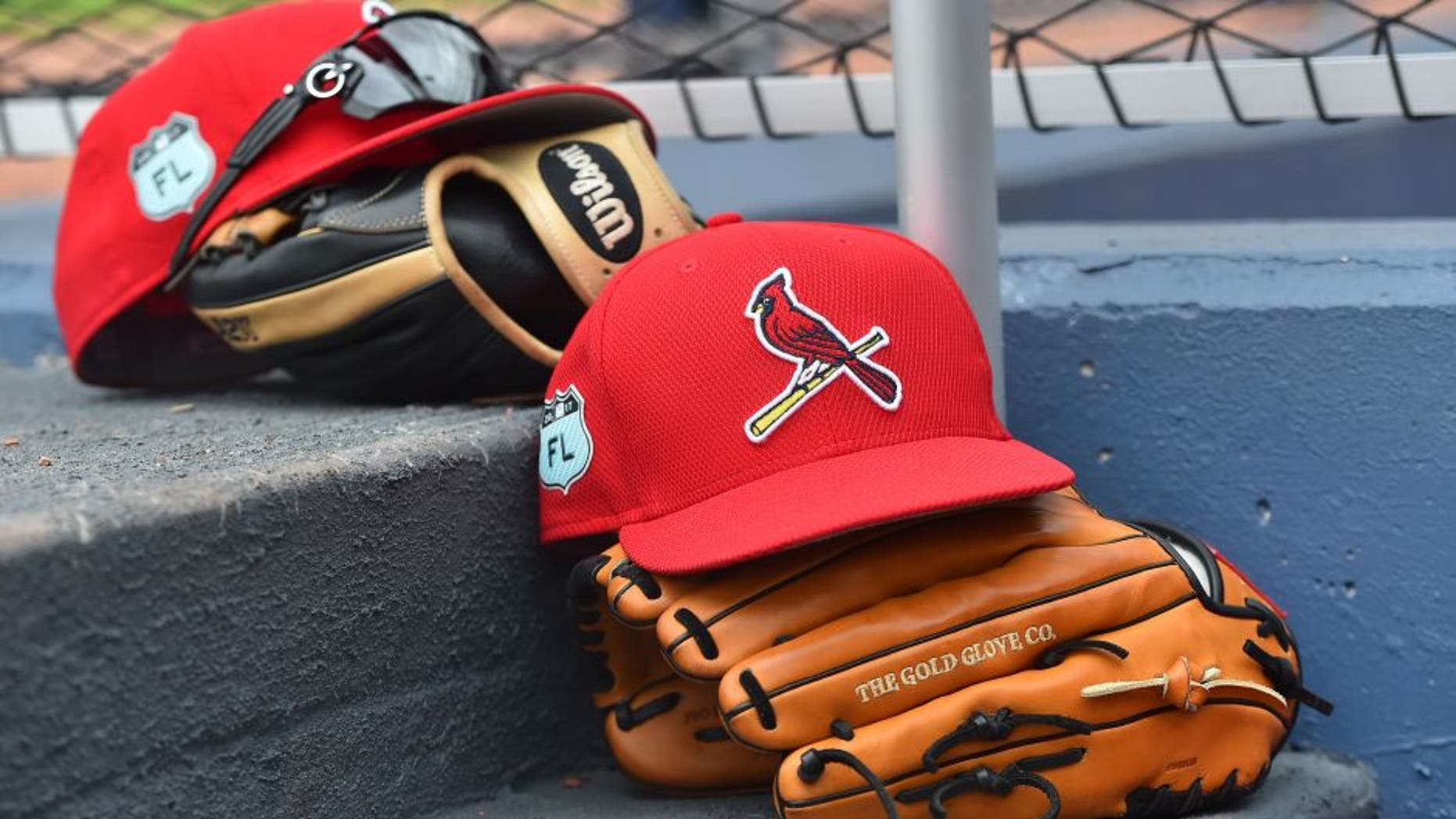 Mar 3, 2017; West Palm Beach, FL, USA; A view of St. Louis Cardinals hats and gloves on the steps of the dugout in the game against the Washington Nationals at The Ballpark of the Palm Beaches. Mandatory Credit: Jasen Vinlove-USA TODAY Sports