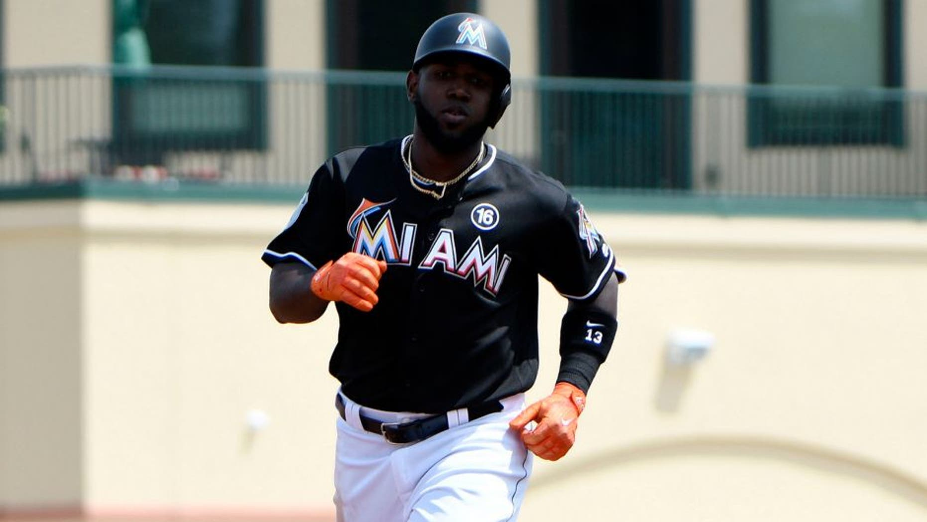 Mar 17, 2017; Jupiter, FL, USA; Miami Marlins center fielder Marcell Ozuna (13) rounds the bases after hitting a three run homer during a spring training game against the Washington Nationals at Roger Dean Stadium. Mandatory Credit: Steve Mitchell-USA TODAY Sports