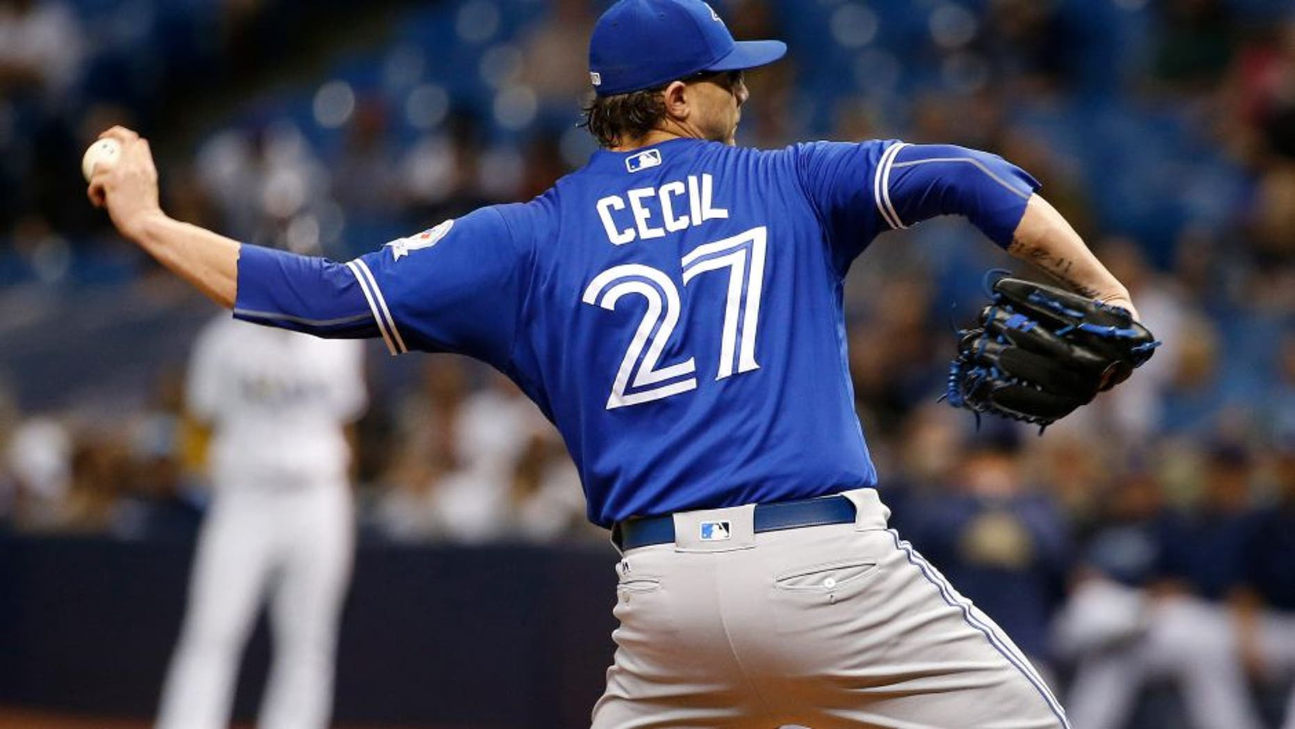 Sep 3, 2016; St. Petersburg, FL, USA; Toronto Blue Jays relief pitcher Brett Cecil (27) throws a pitch against the Tampa Bay Rays at Tropicana Field. Mandatory Credit: Kim Klement-USA TODAY Sports